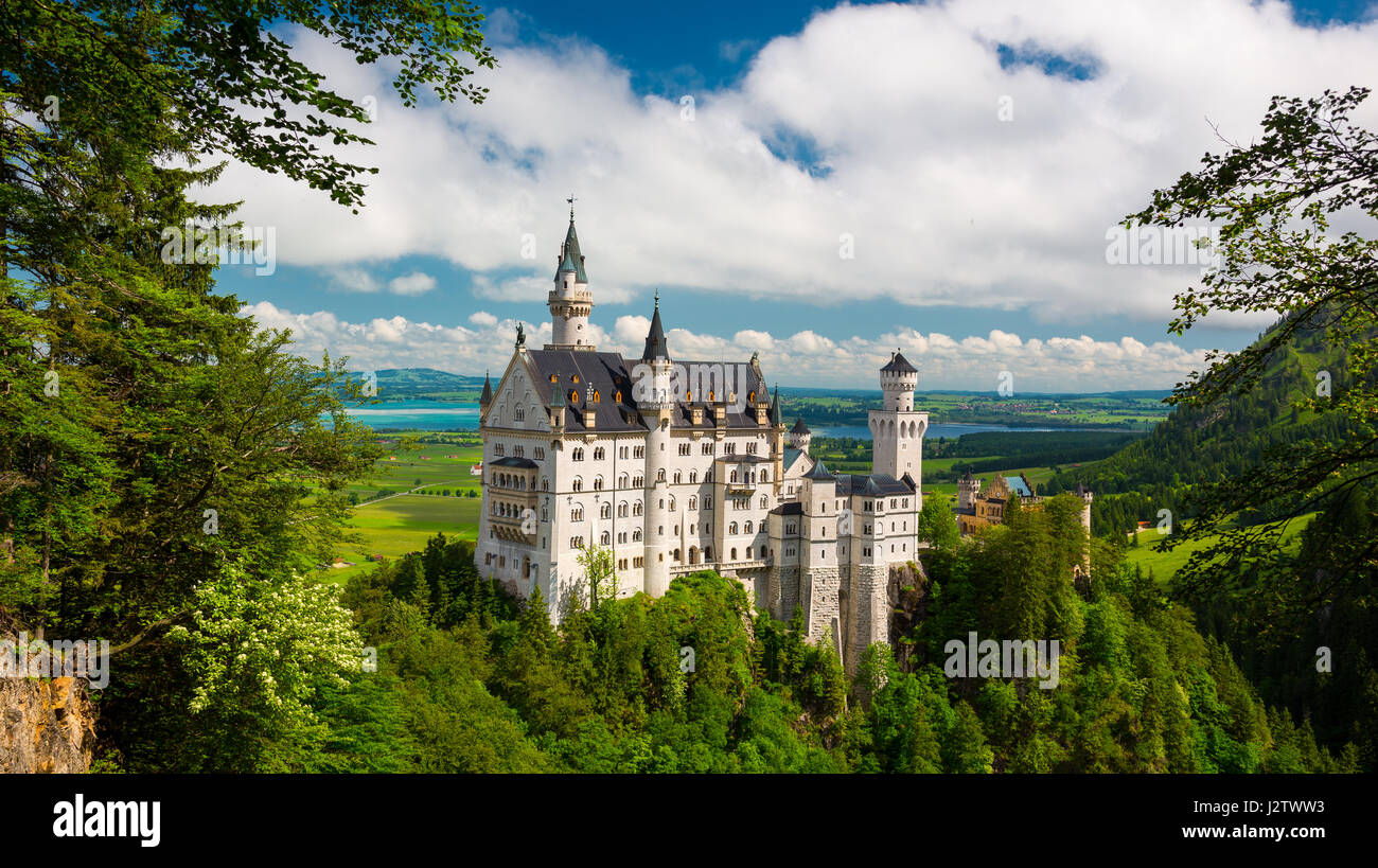 Medieval castle Neuschwanstein. Around the blue sky and the Alps. Beautiful view of the castle. Open landmark and - Stock Image