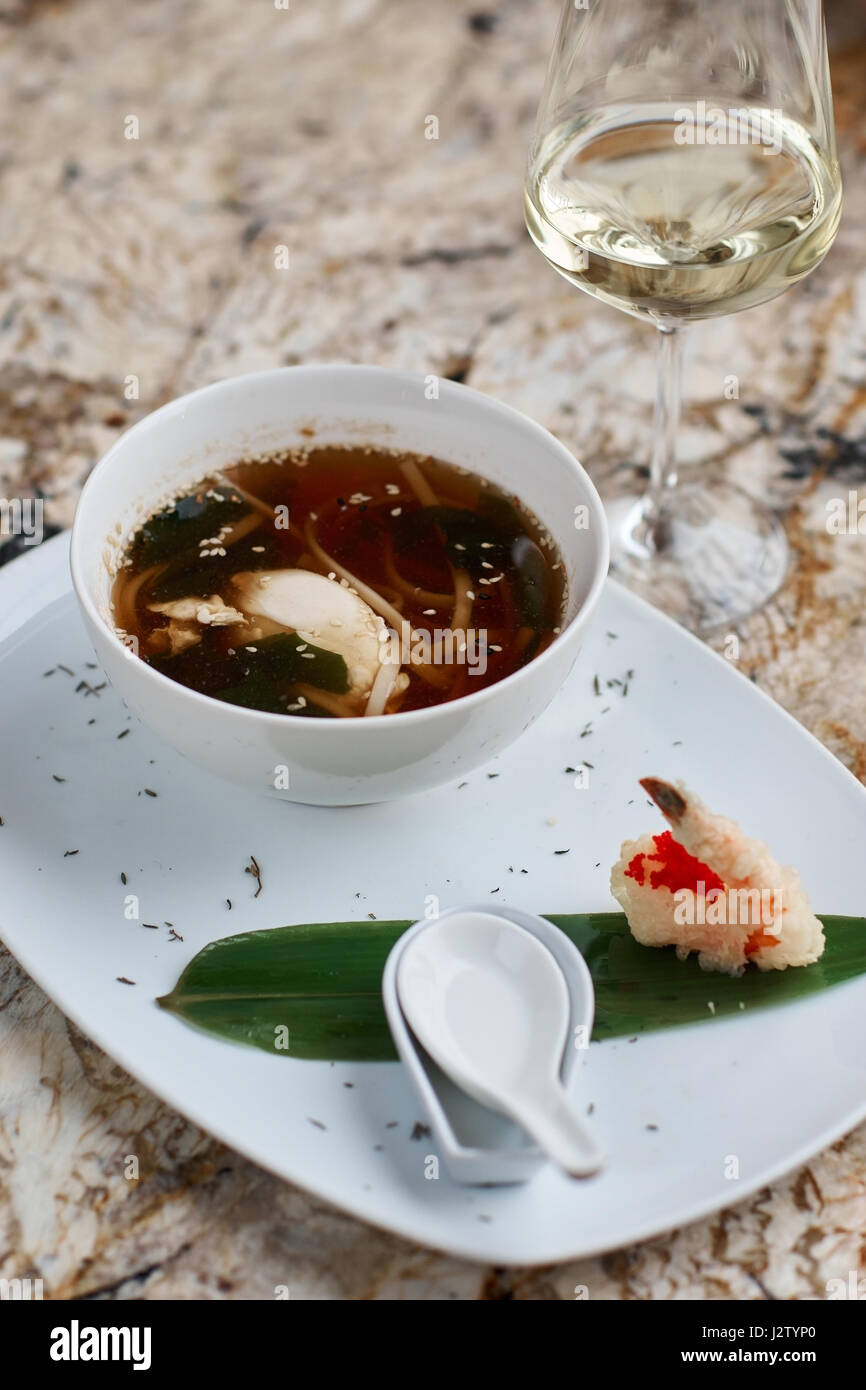 Japanese noodle soup udon in bowl - Stock Image