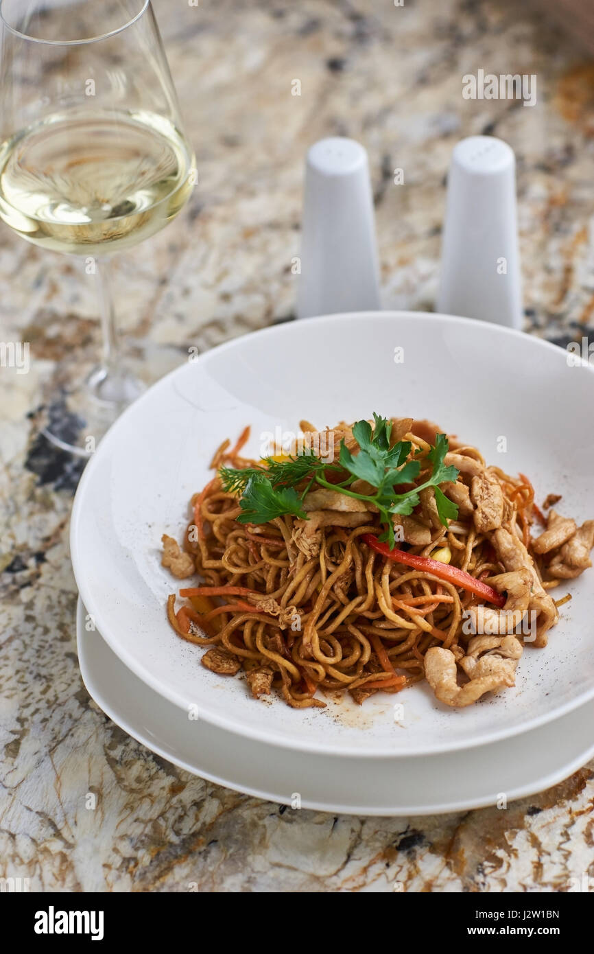Thin noodles with chicken slices Stock Photo