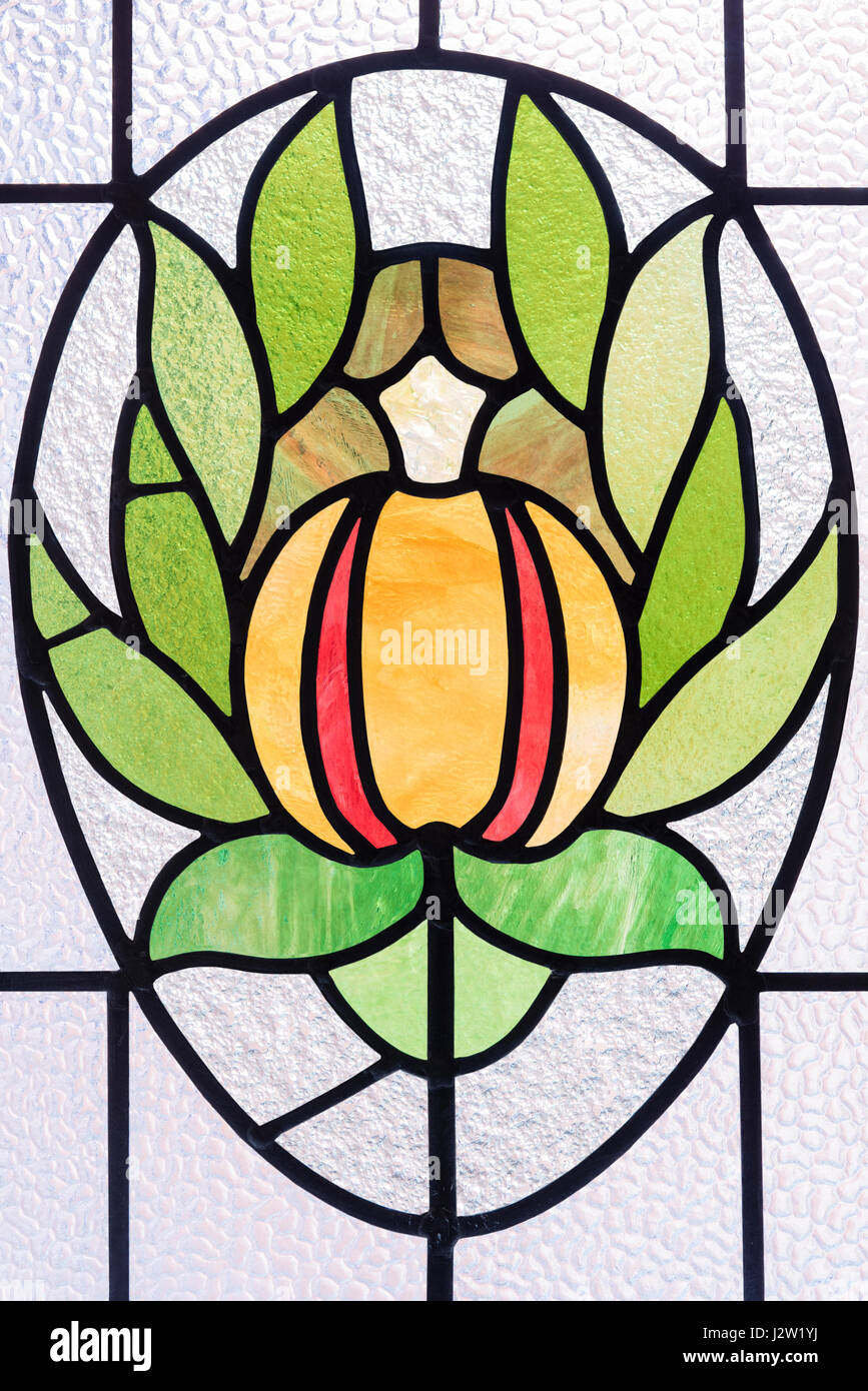 Stylised water lily depicted in stained glass, Victoria Baths, Manchester, England. - Stock Image