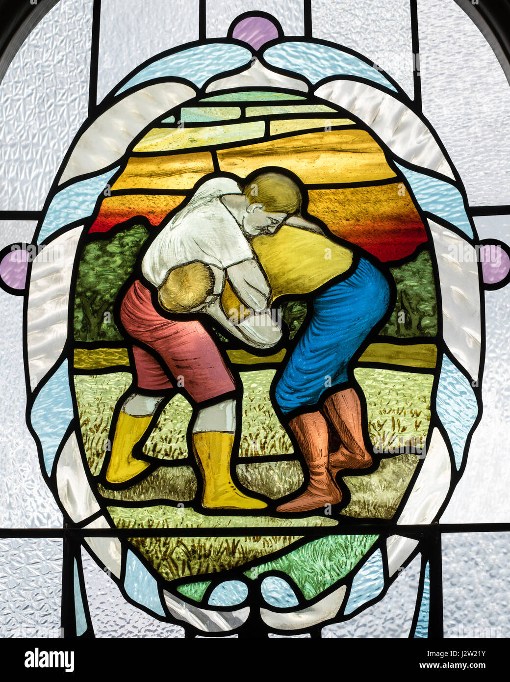 Wrestlers, from the Edwardian era, depicted in a stained glass window, Victoria Baths, Manchester, England - Stock Image