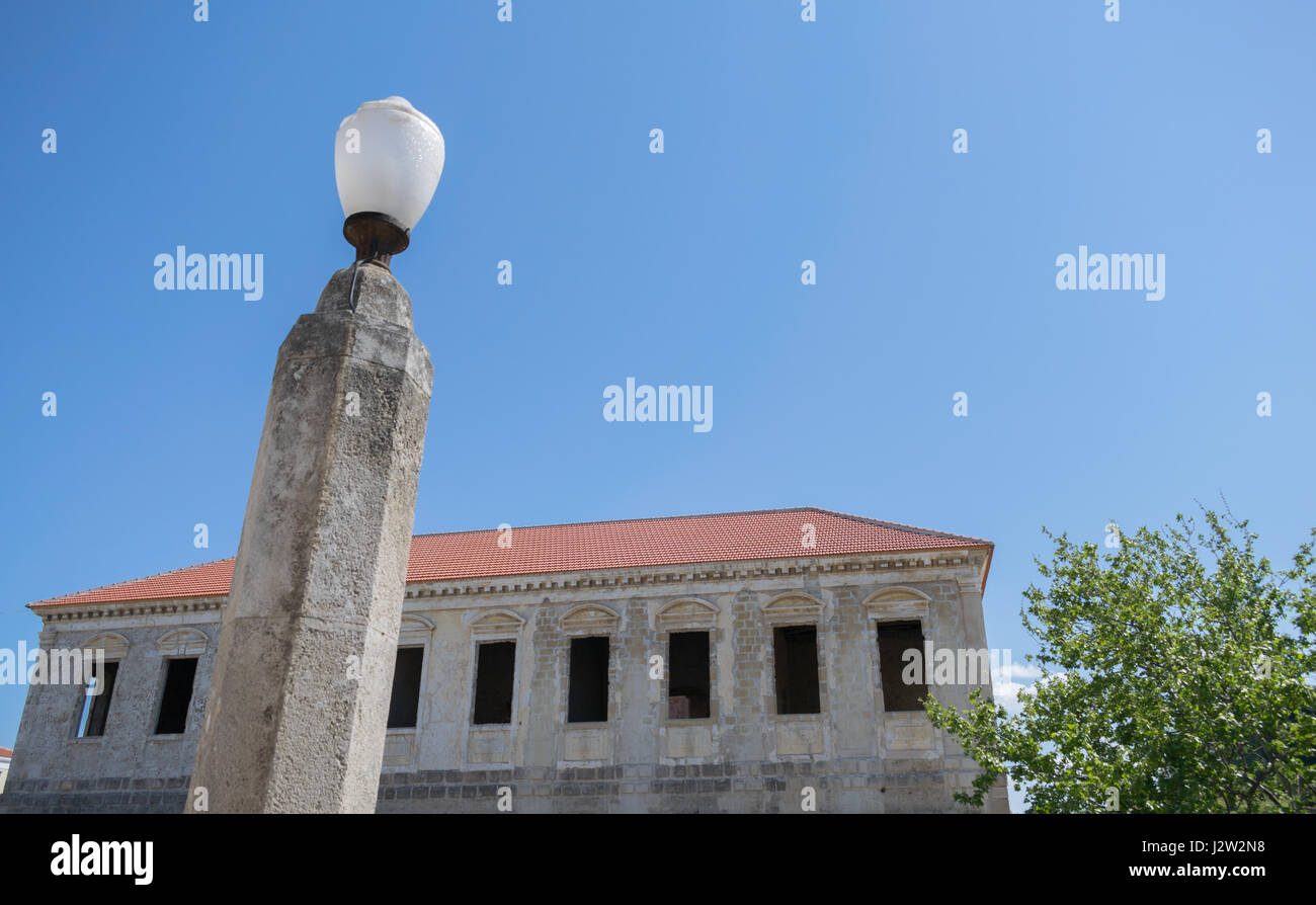 tree lamp old public building and clear blue sky - Stock Image