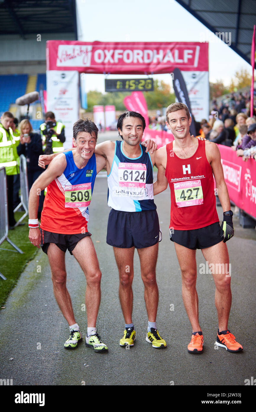 Runners at the finish of the 2014 Oxford Half Marathon - Stock Image