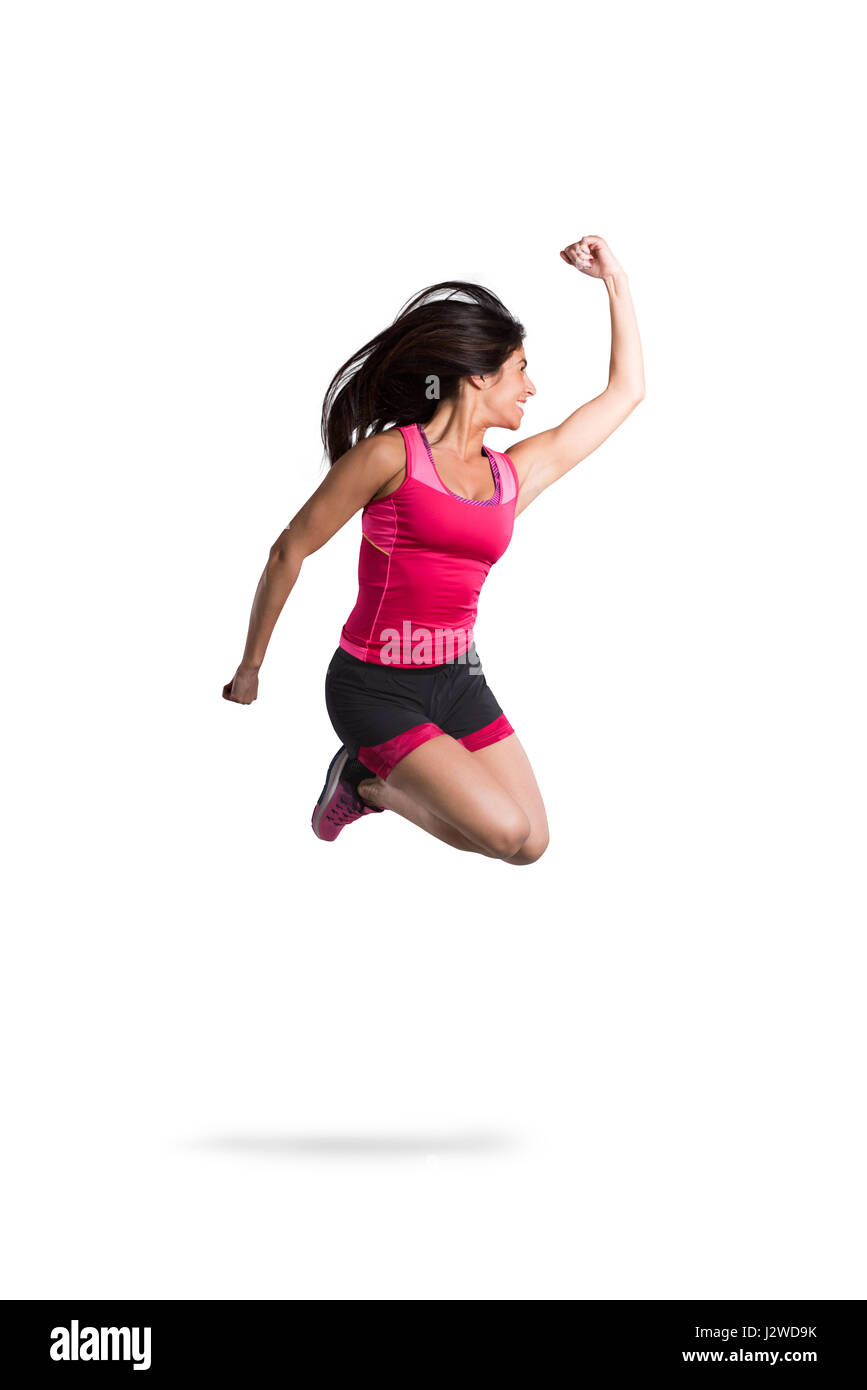 Vital and athletic girl jump - Stock Image