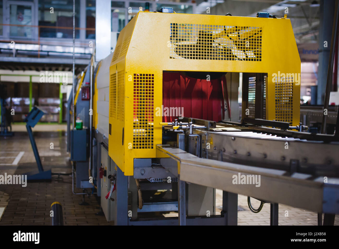 Beer production line. Equipment for the staged production and bottling of the finished product. Special industrial technological device at the factory Stock Photo