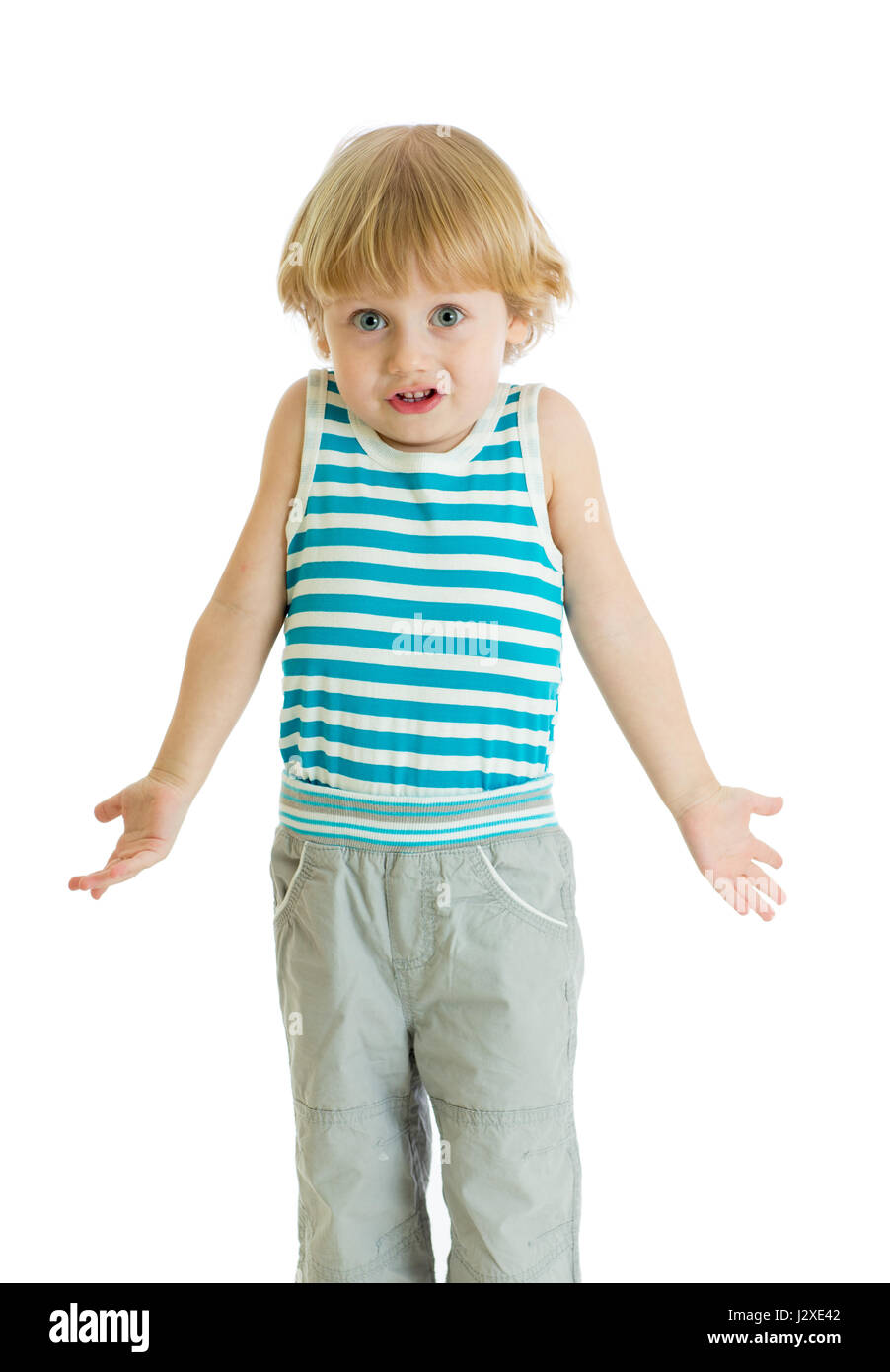 Shrugging child. Kid boy looks puzzled, isolated - Stock Image