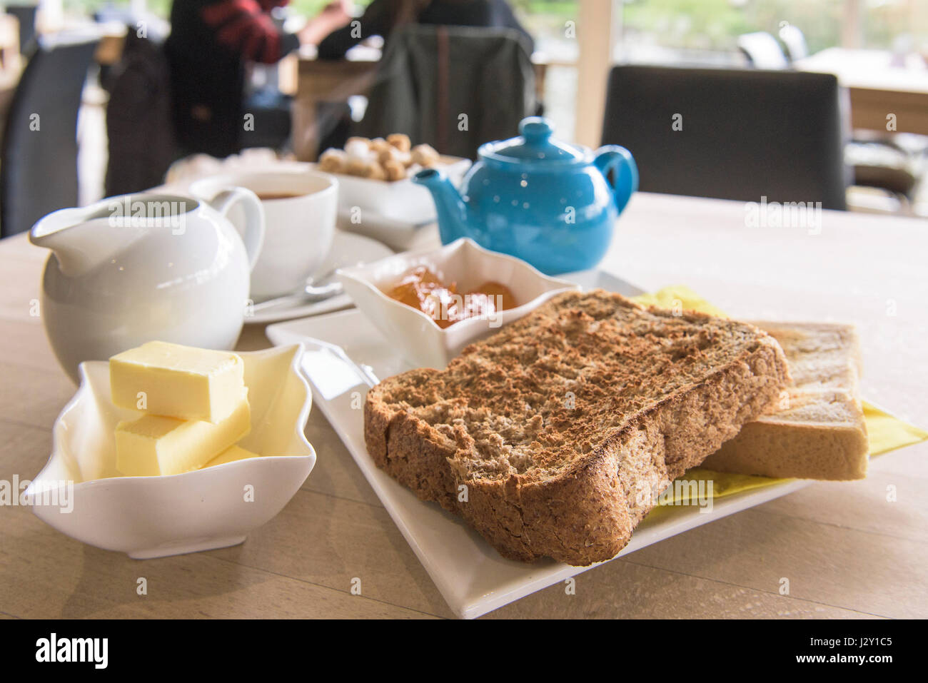 Food Breakfast Tea Toast and marmalade Toast slices Teapot Crockery Morning meal Restaurant Cafe - Stock Image