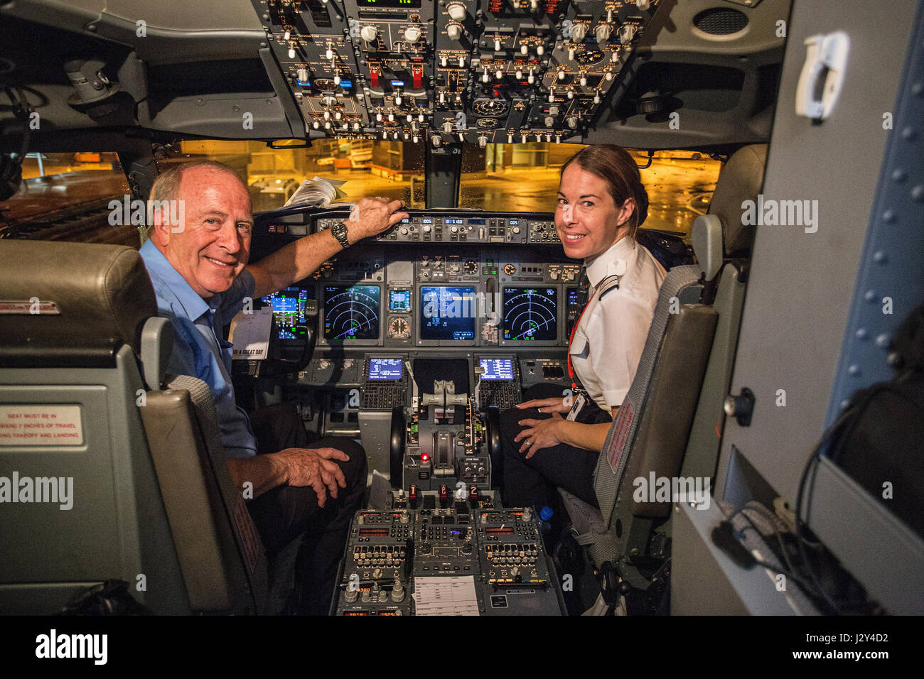 cockpit of modern jetliner with female co-pilot - Stock Image