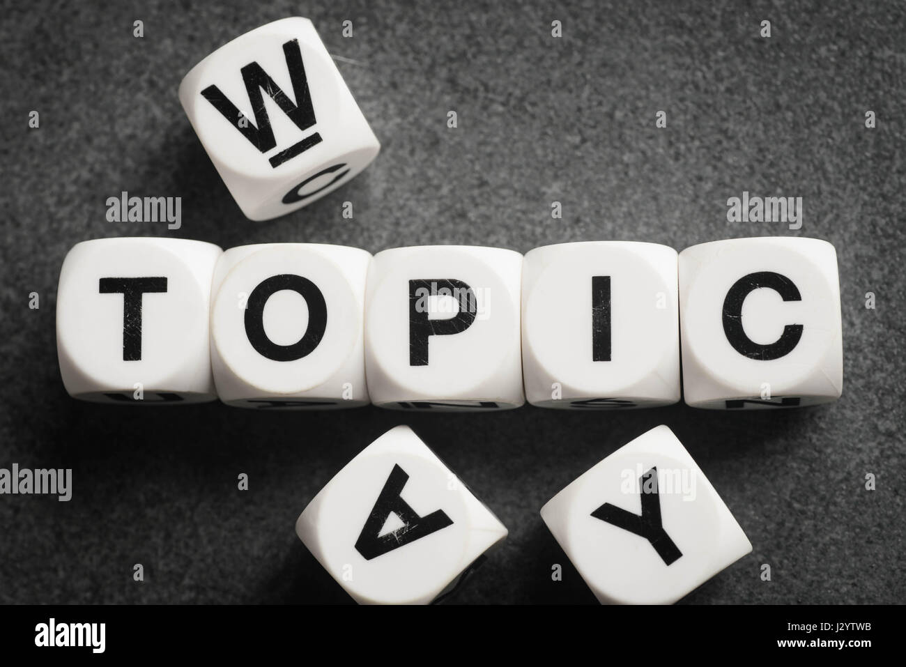 word topic on white toy cubes - Stock Image