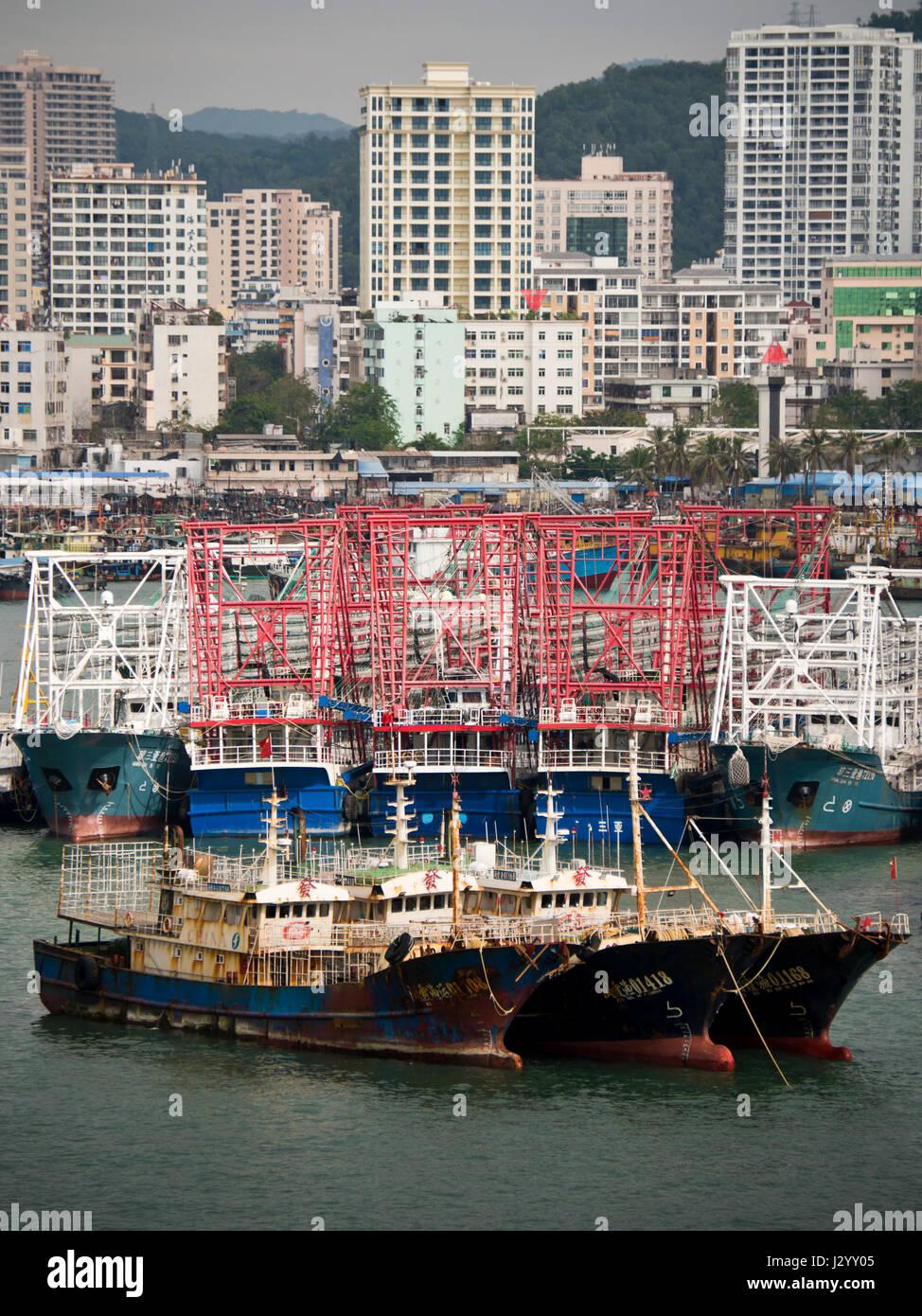 Vertical aerial view of fishing boats moored up in Sanya Bay, Hainan Island, China. - Stock Image