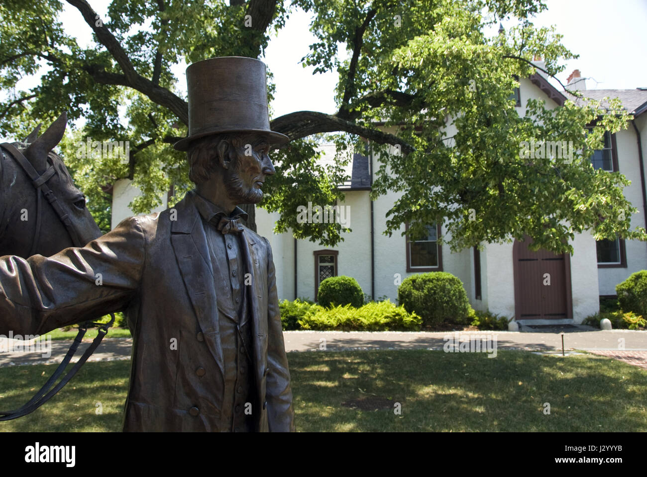"A bronze statue of President Lincoln at Lincoln's Cottage, a national monument at the former ""Soldiers' Home,"" Washington, DC. Stock Photo"