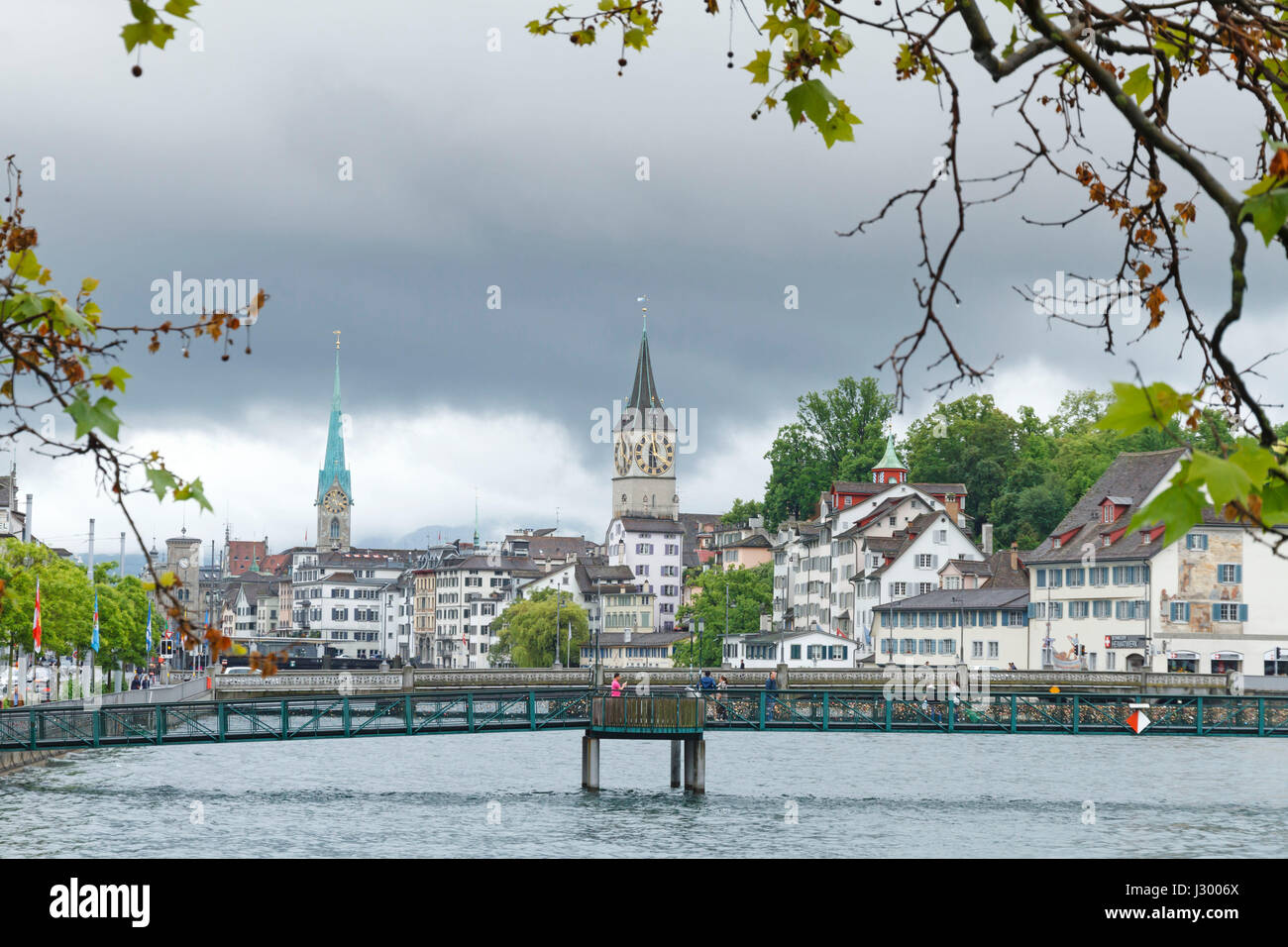 The river Limmat flowing from Lake Zurich through Zurich City, Switzerland - Stock Image