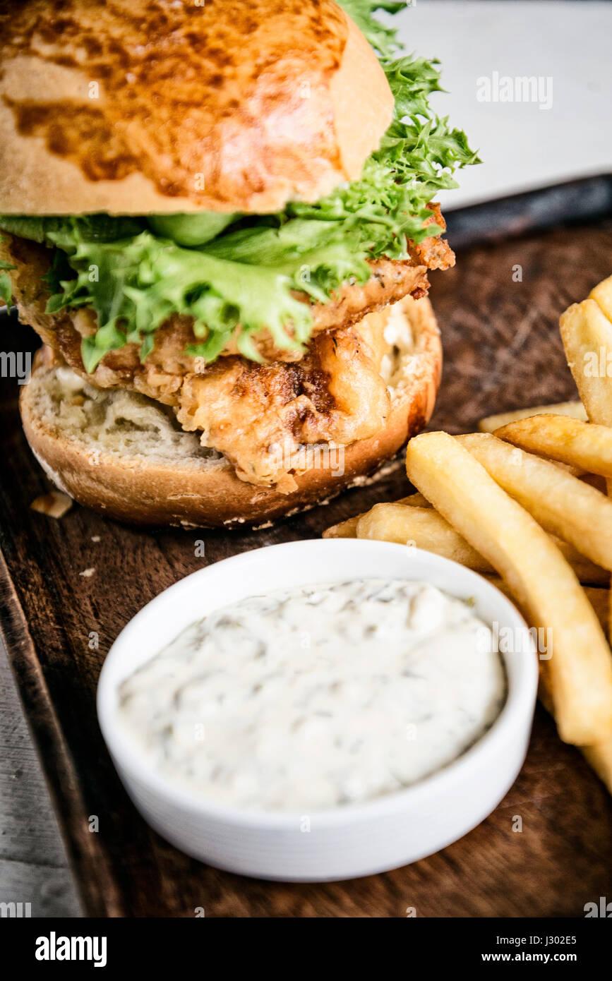 fish fillet burger with fries and tartar sauce  set snack meal - Stock Image