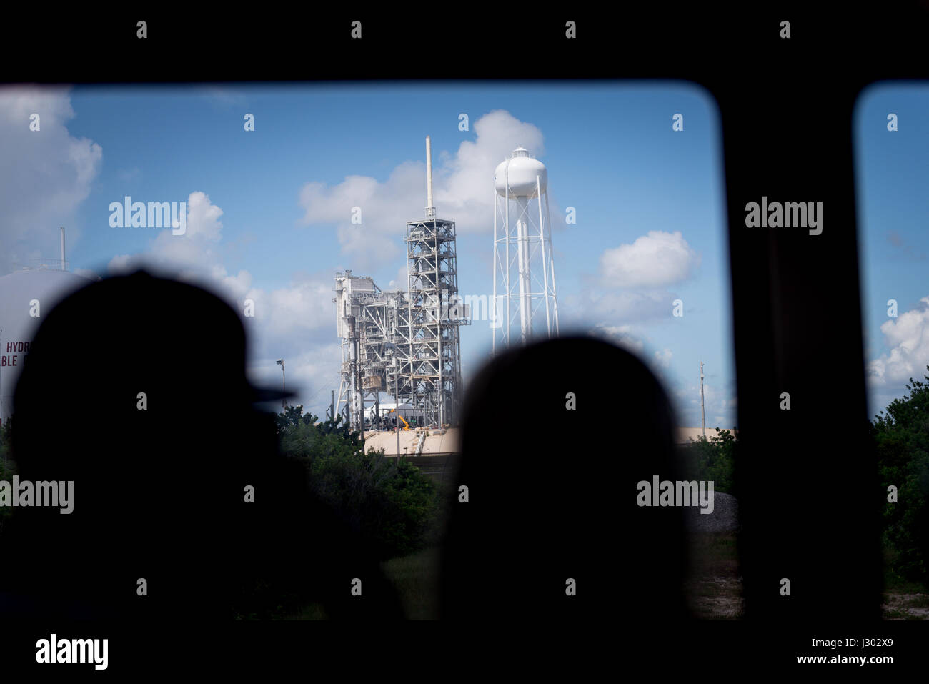 Tourist looking at the Kennedy Space Center launch complex. - Stock Image