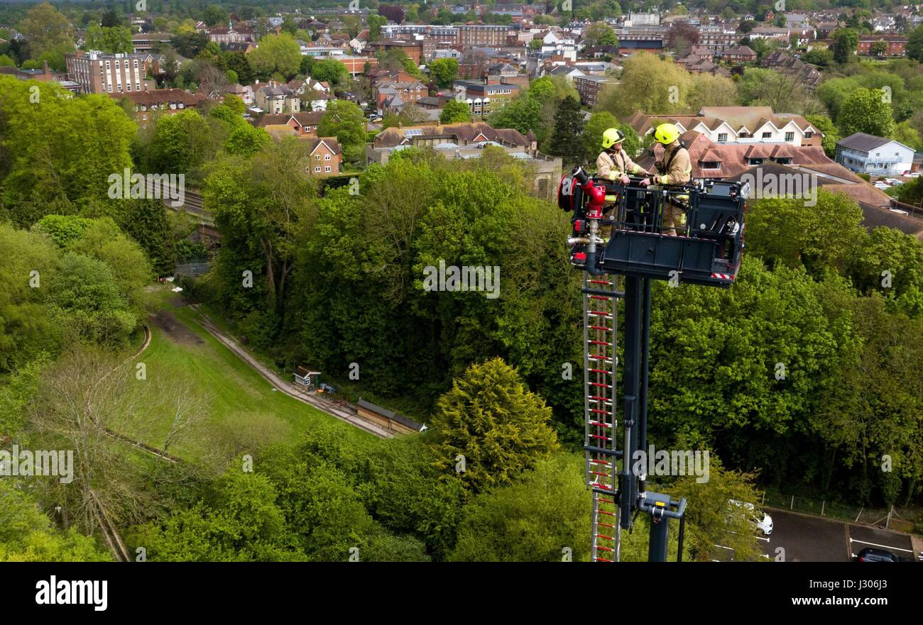 Fire Fighters From Surrey And Rescue Service Train Leatherhead On Their Aerial Ladder Platform Which Can Reach Height Of Is
