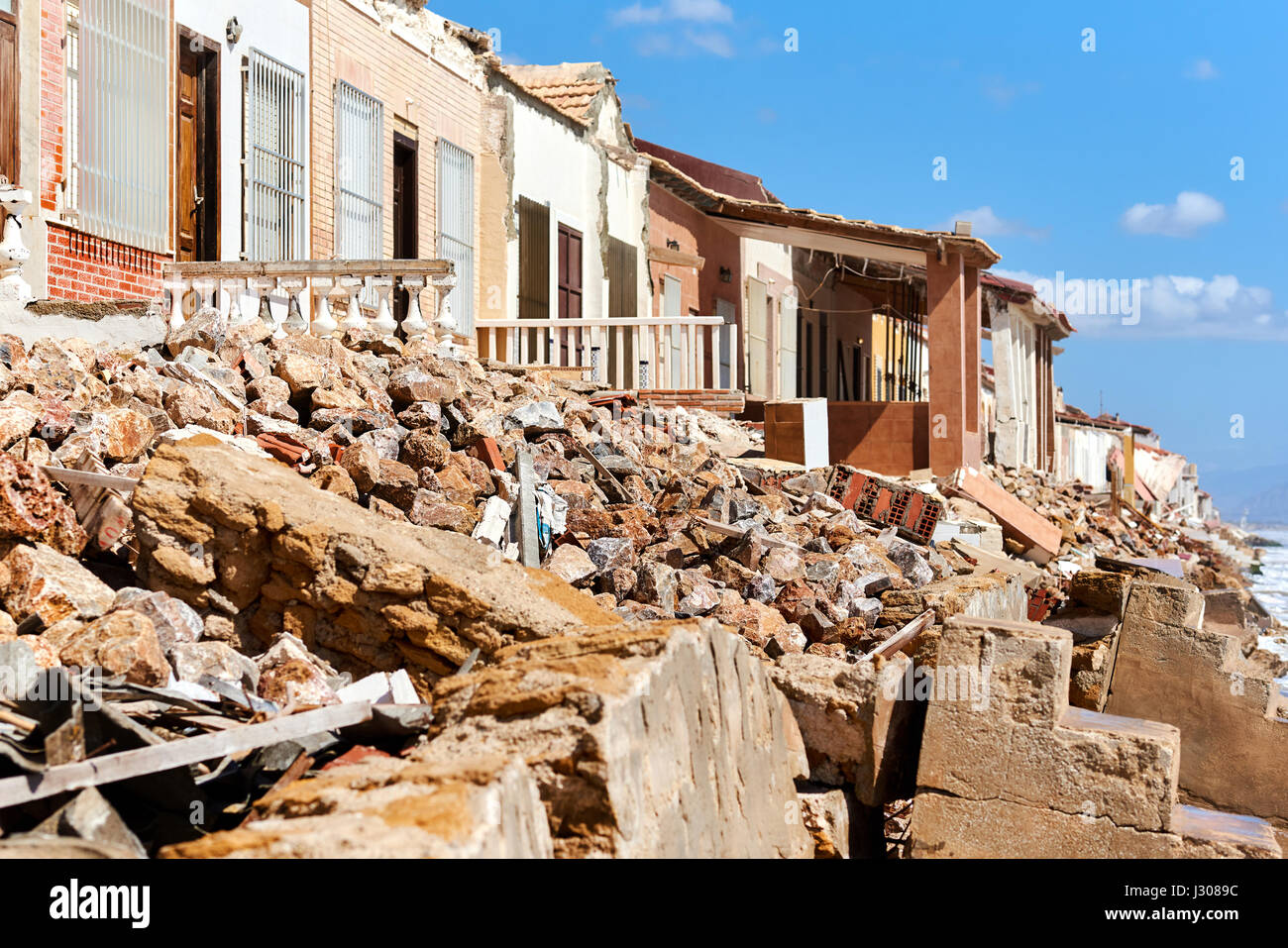 Damaged beach houses. The wind and waves is washed away the beach houses on the Babilonia beach. Guardamar del Segura. - Stock Image