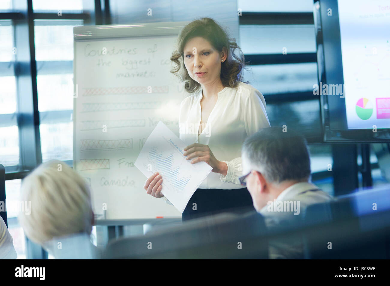 Business presentation by female coworker - Stock Image