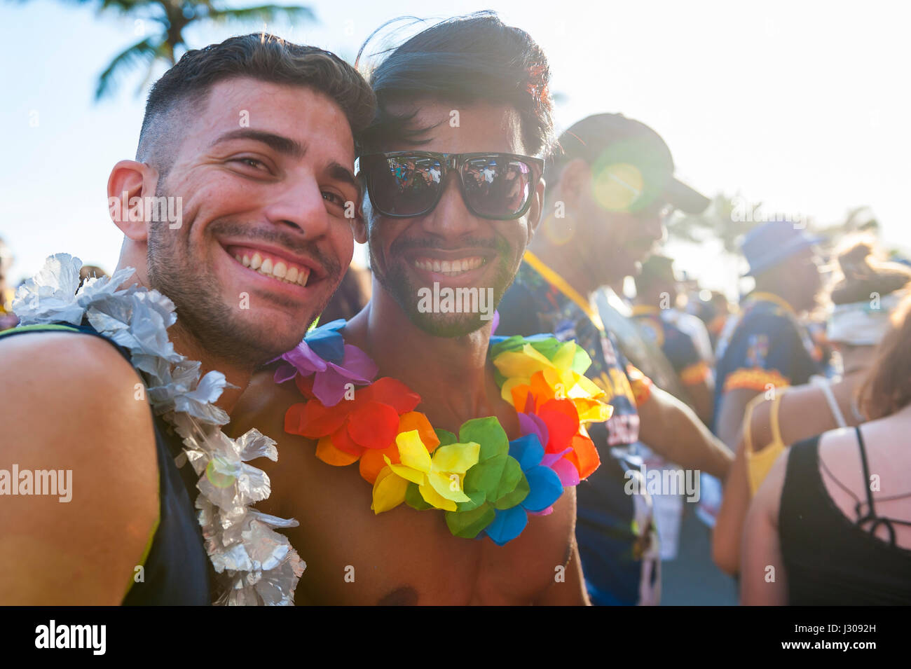 RIO DE JANEIRO - FEBRUARY 11, 2017: Young Brazilian friends celebrate carnival at a street party in Ipanema. - Stock Image