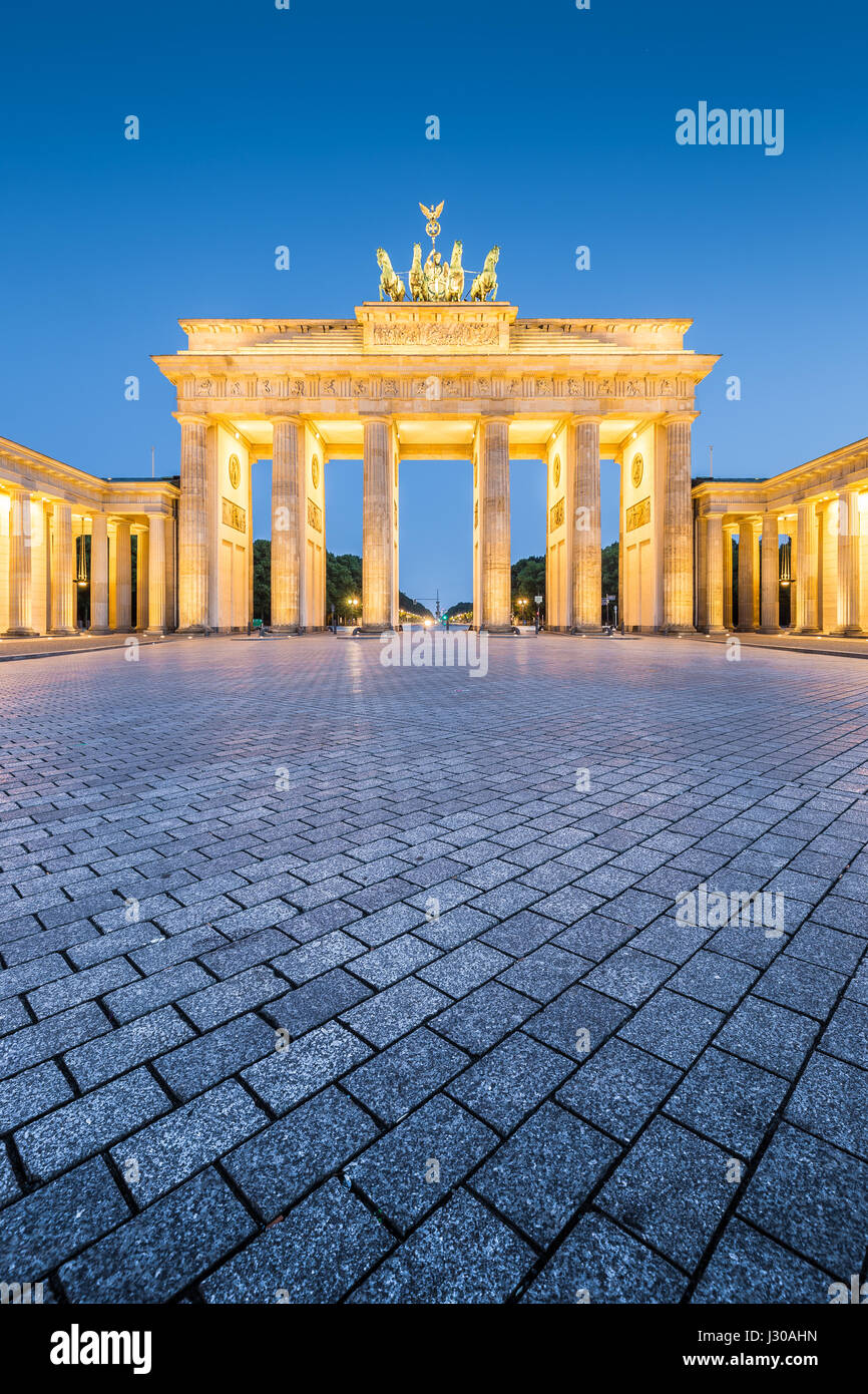 Historic Brandenburg Gate, Germany's most famous landmark and a national symbol, in post sunset twilight during - Stock Image