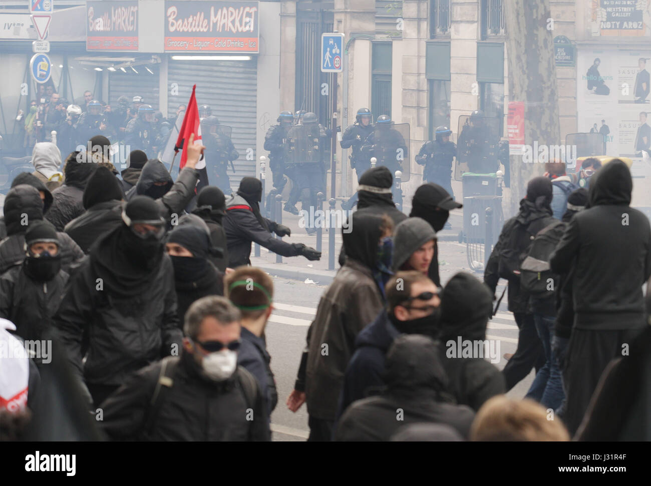 Paris, France. 1st May, 2017. Protester face French anti-riot police during a march for the annual May Day workers' rally in Paris on May 1, 2017. Credit: VWPics/Alamy Live News Stock Photo
