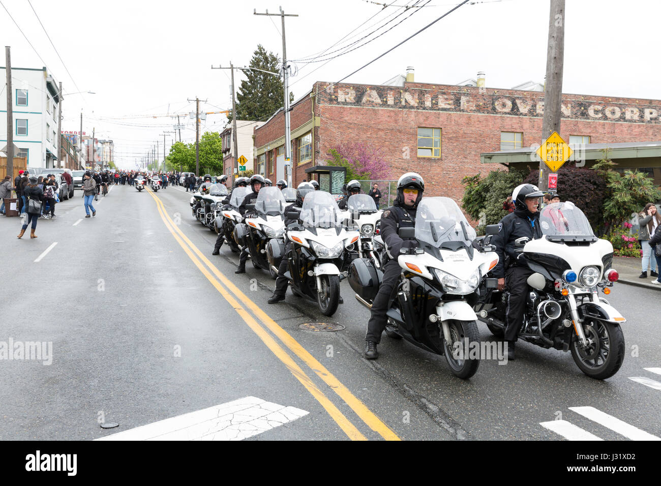 Seattle, USA. 01st May, 2017. Seattle motorcycle police lead the way at the May Day March for Workers and Immigrant - Stock Image