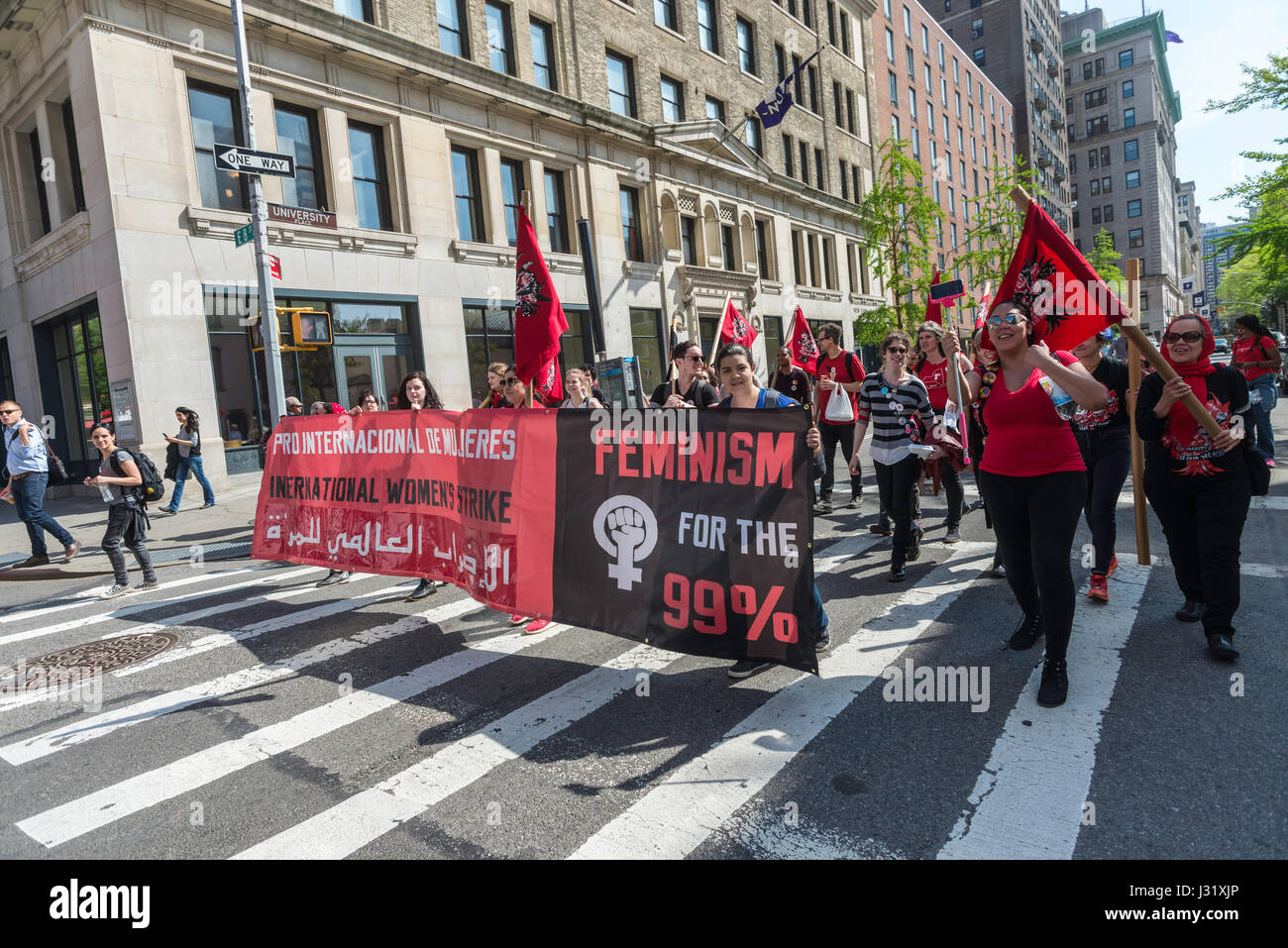 New York, USA. 01st May, 2017. New York, NY 1 May 2017 - Socialists, dressed in red, march up University Place, - Stock Image