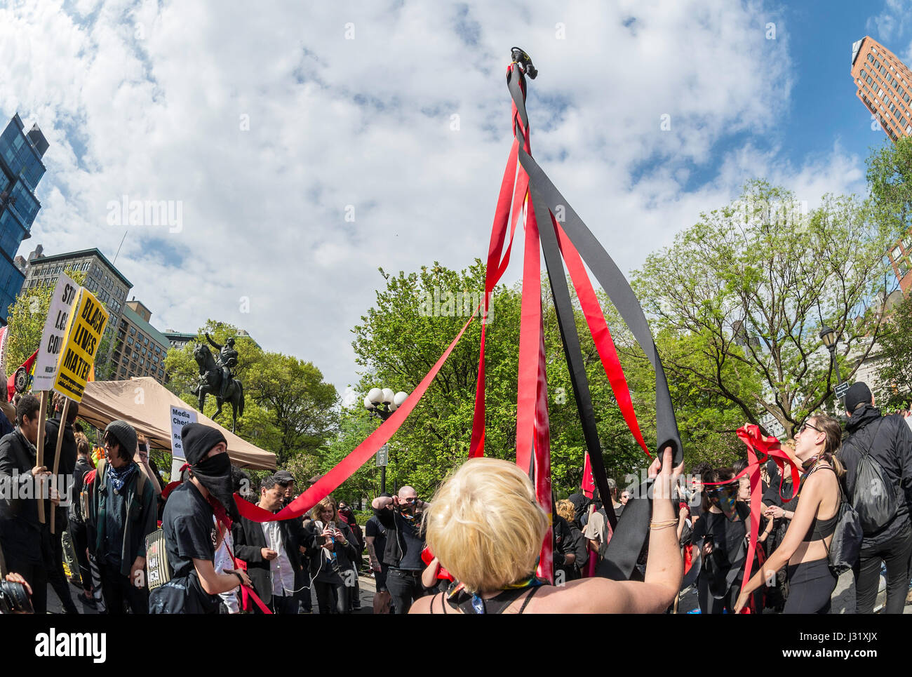 New York, NY 1 May 2017 - Anarchists dance around a Maypole at a May Day/International Workers Day rally in Union - Stock Image
