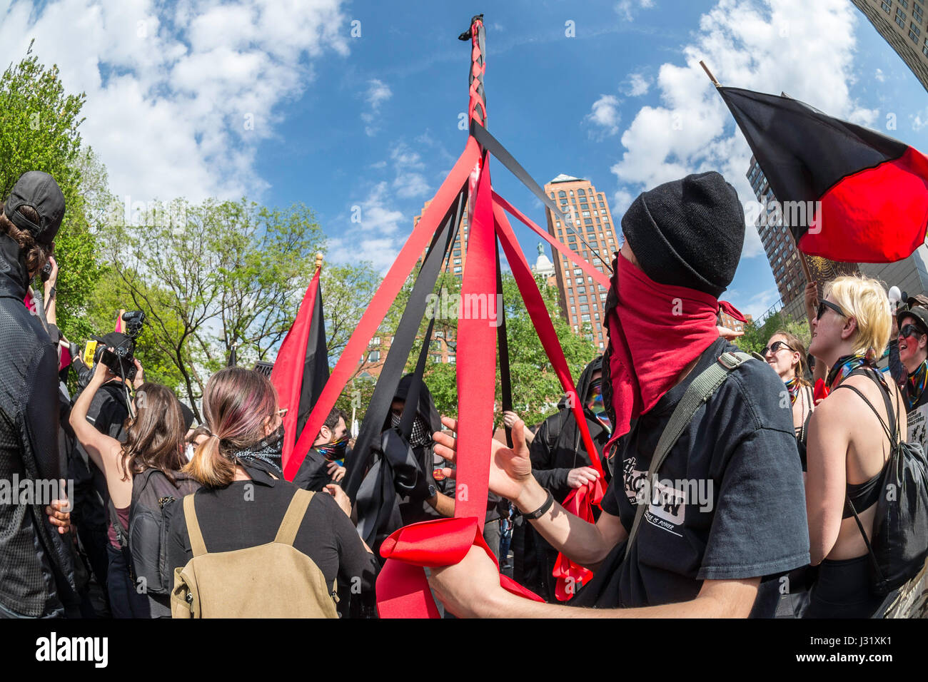 New York, USA. 01st May, 2017. New York, NY 1 May 2017 - Anarchists dance around a Maypole at a May Day/International - Stock Image