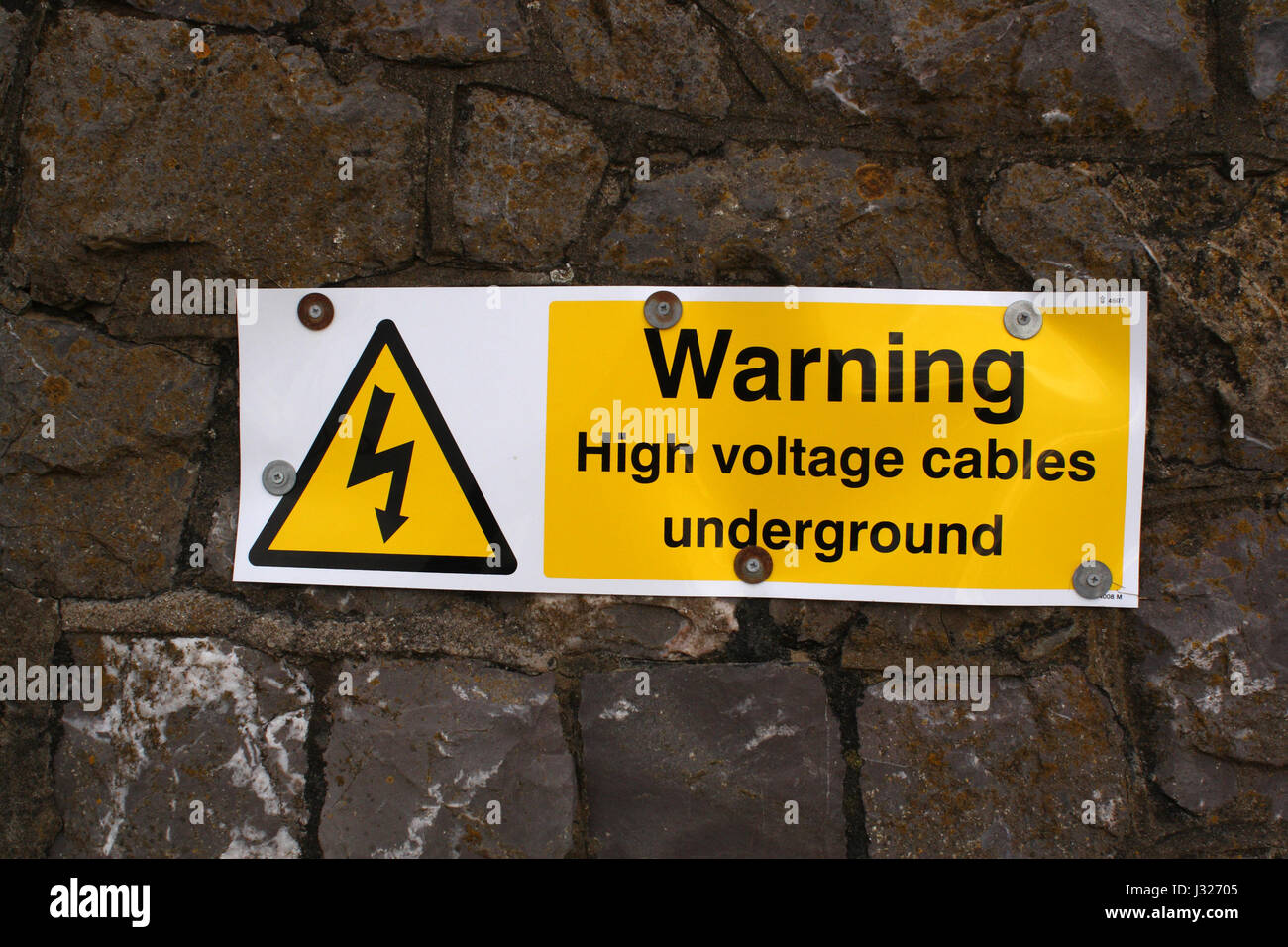 7th April 2008 - Warning high voltage cable sign fixed to a wall - Stock Image