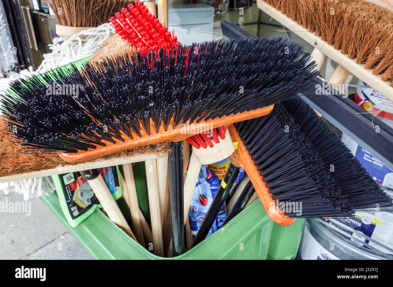 New Brooms for sale in London - Stock Image