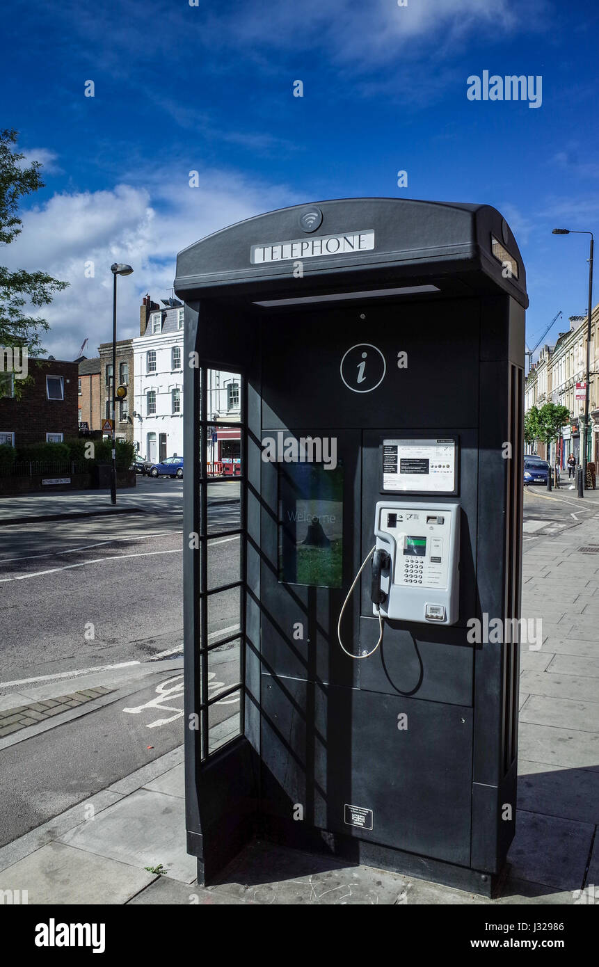 An advanced, new style telephone kiosk/advertising board in London's Bethnal Green Road - Stock Image