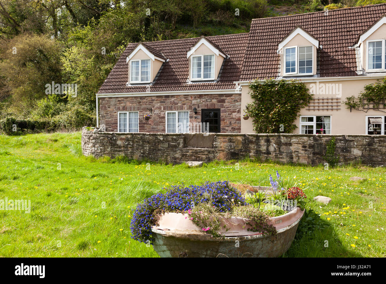 Cottages in the tiny hamlet of Gatcombe on the west bank of the River Severn in Gloucestershire UK - Stock Image