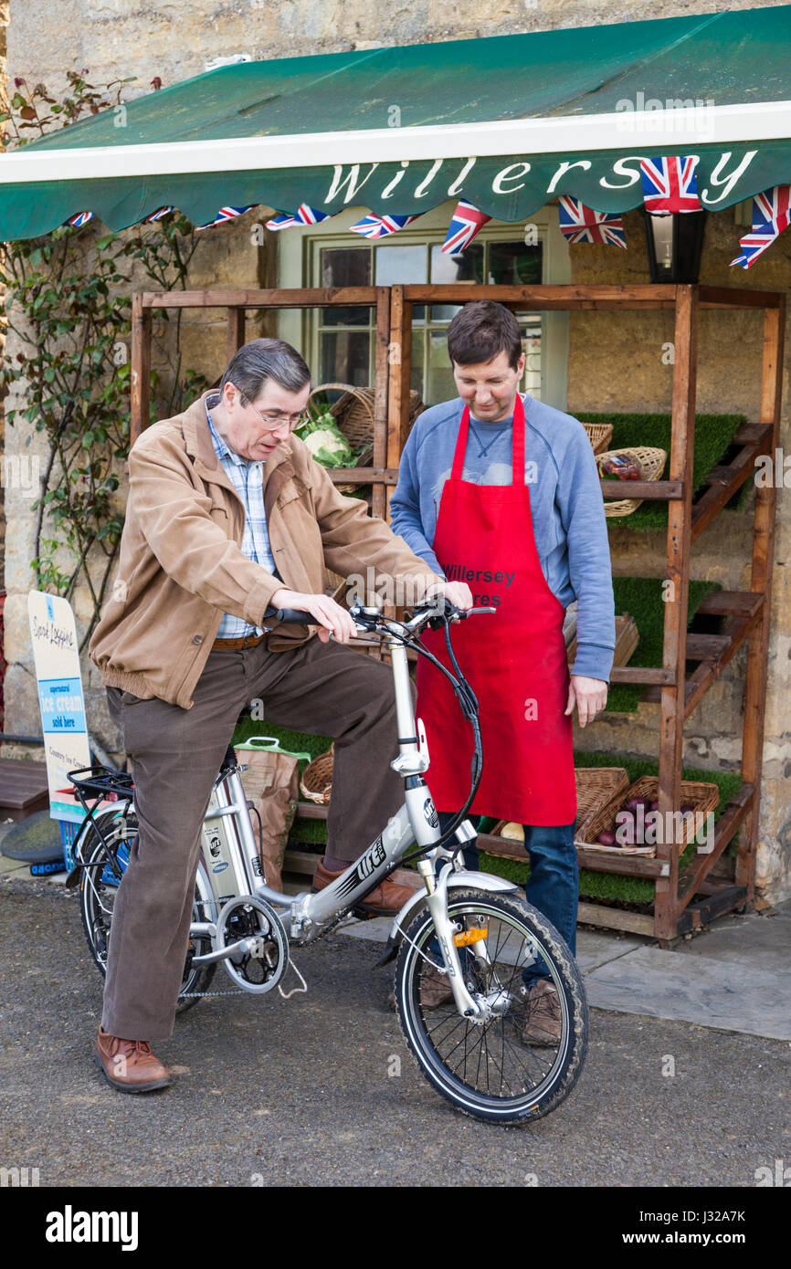 An electric bike hire outlet for tourists to the Cotswolds at the village stores in Willersey, Gloucestershire UK - Stock Image