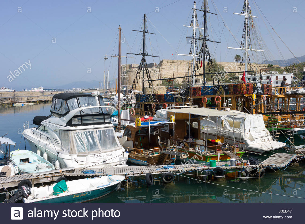 Yachts, tall ships and pleasure craft in the harbour at Kyrenia, northern Cyprus with the castle in the background Stock Photo