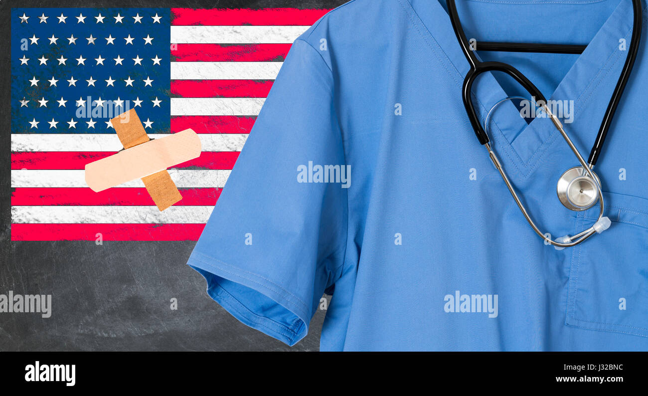 Blue doctor scrubs and stethoscope in front of USA flag. American healthcare, medicare, health insurance concept - Stock Image