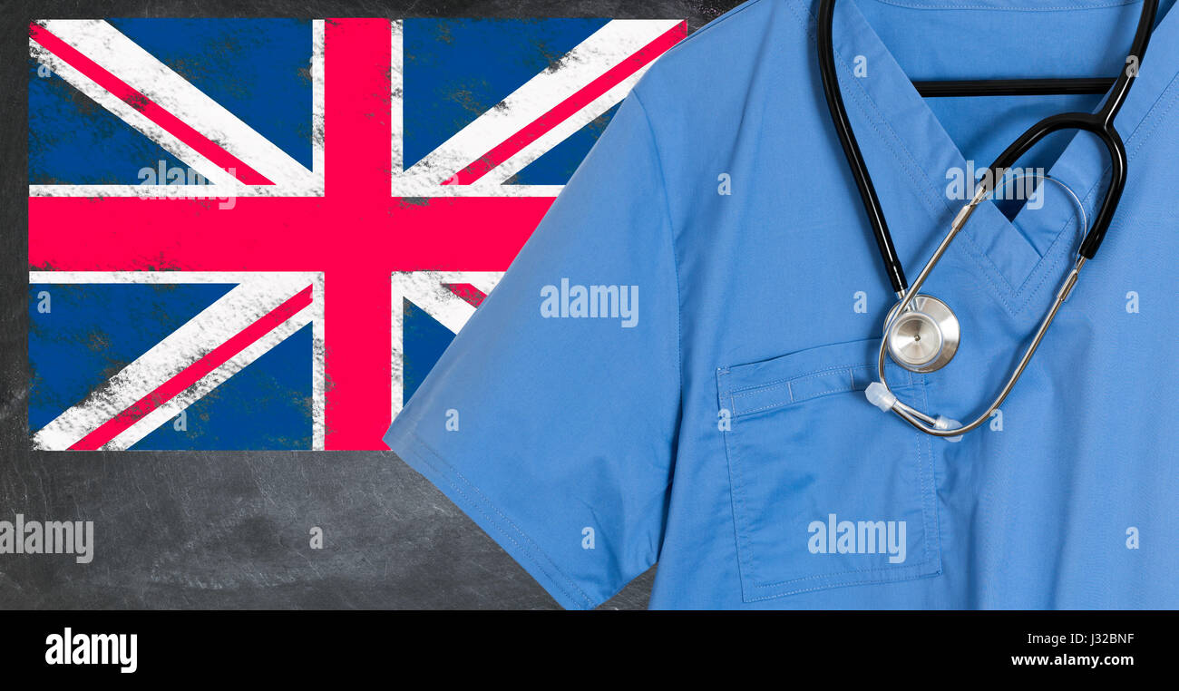 Doctors scrubs and stethoscope in front of Union Jack flag. NHS healthcare UK, medical concept - Stock Image