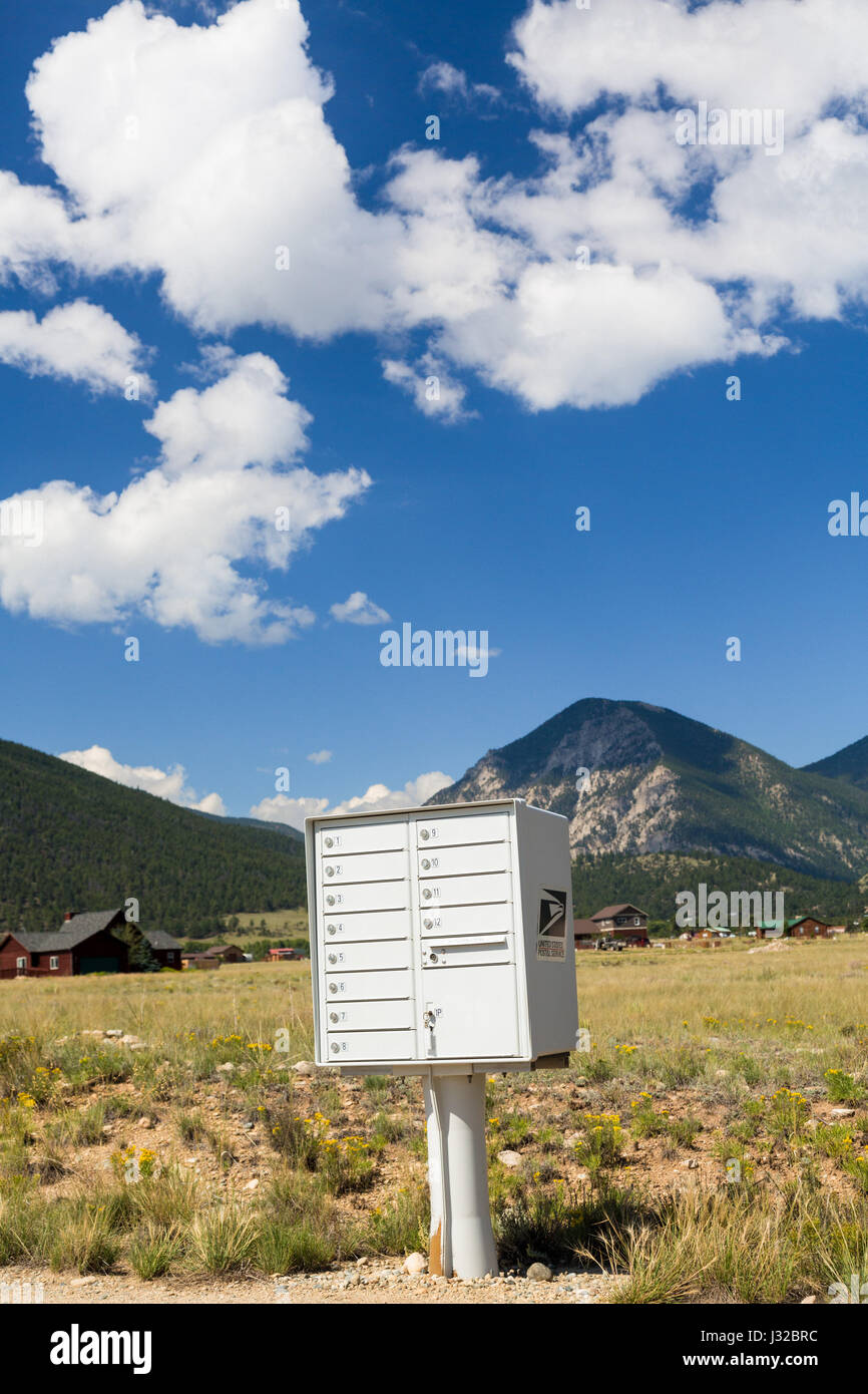 US mailbox container for rural homes by the mountains of Colorado, USA - Stock Image