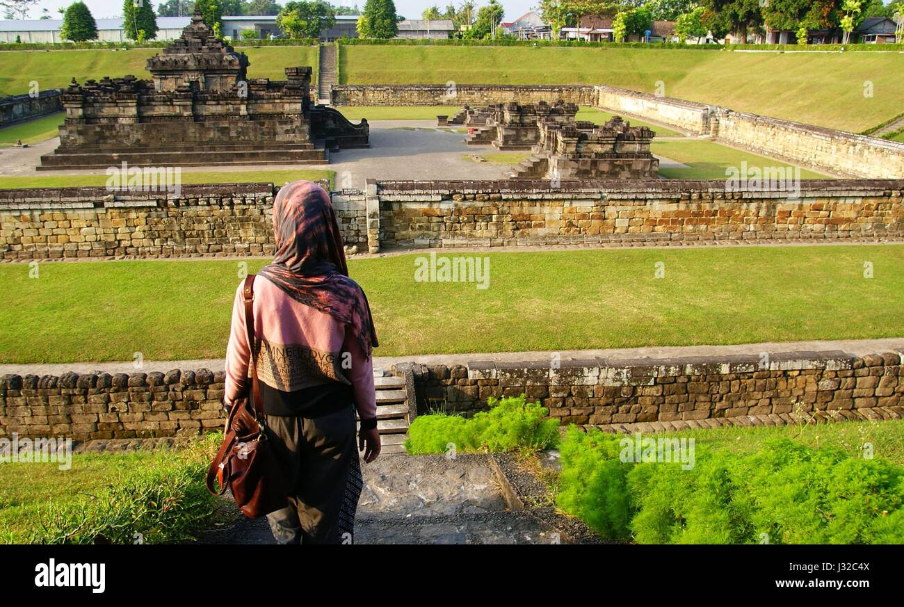 A hijab traveler visiting Sambisari Temple in Yogyakarta, Indonesia - Stock Image