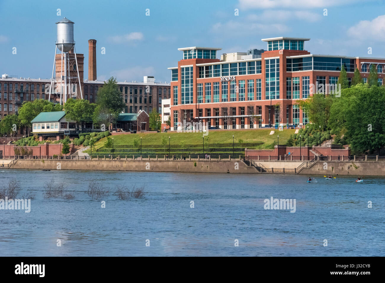 Columbus, Georgia's iconic water tower, mill stacks, and the Synovus headquarters building along the Chattahoochee - Stock Image