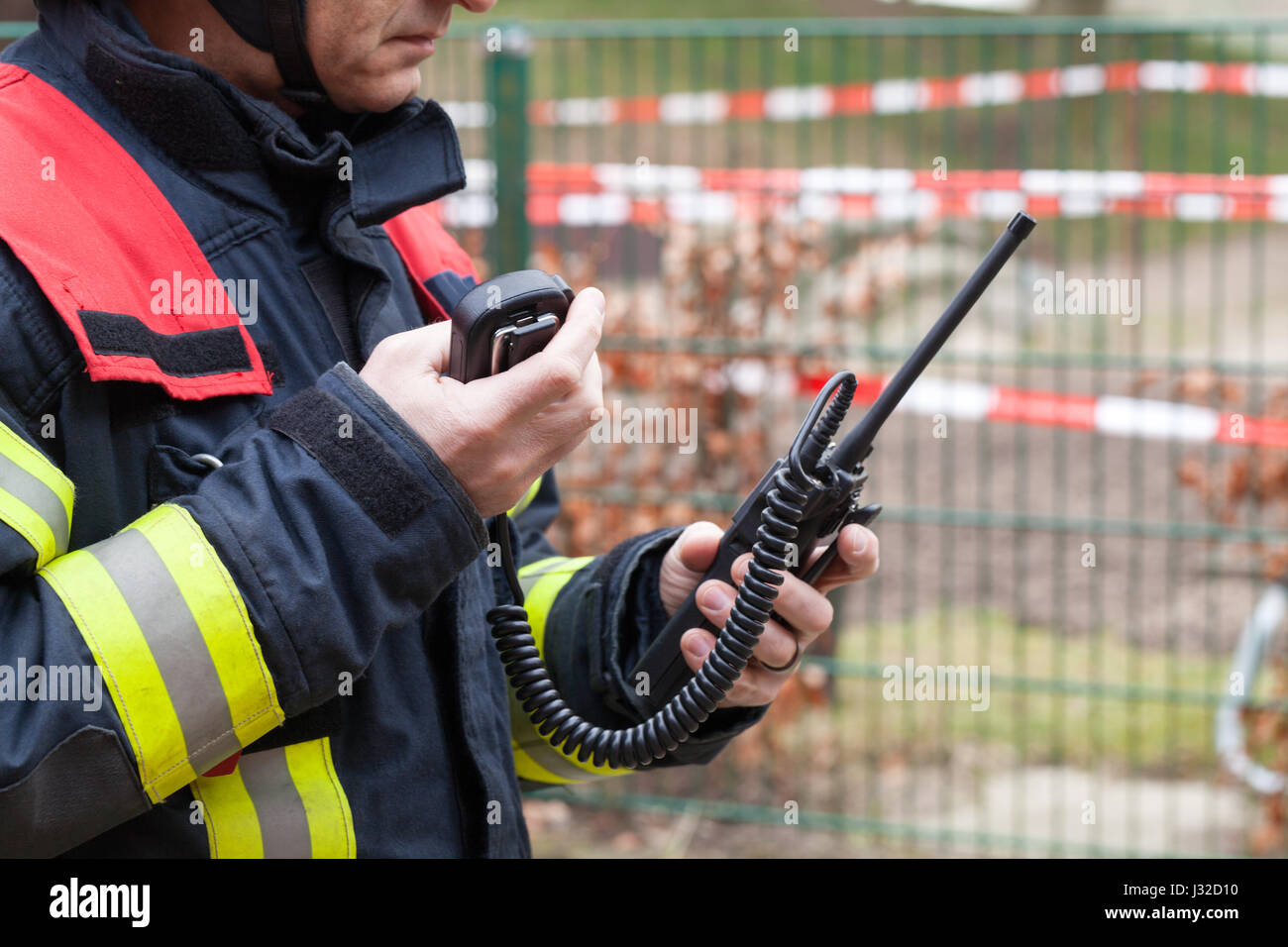 German firefighter leader used a walkie talkie in action Stock Photo