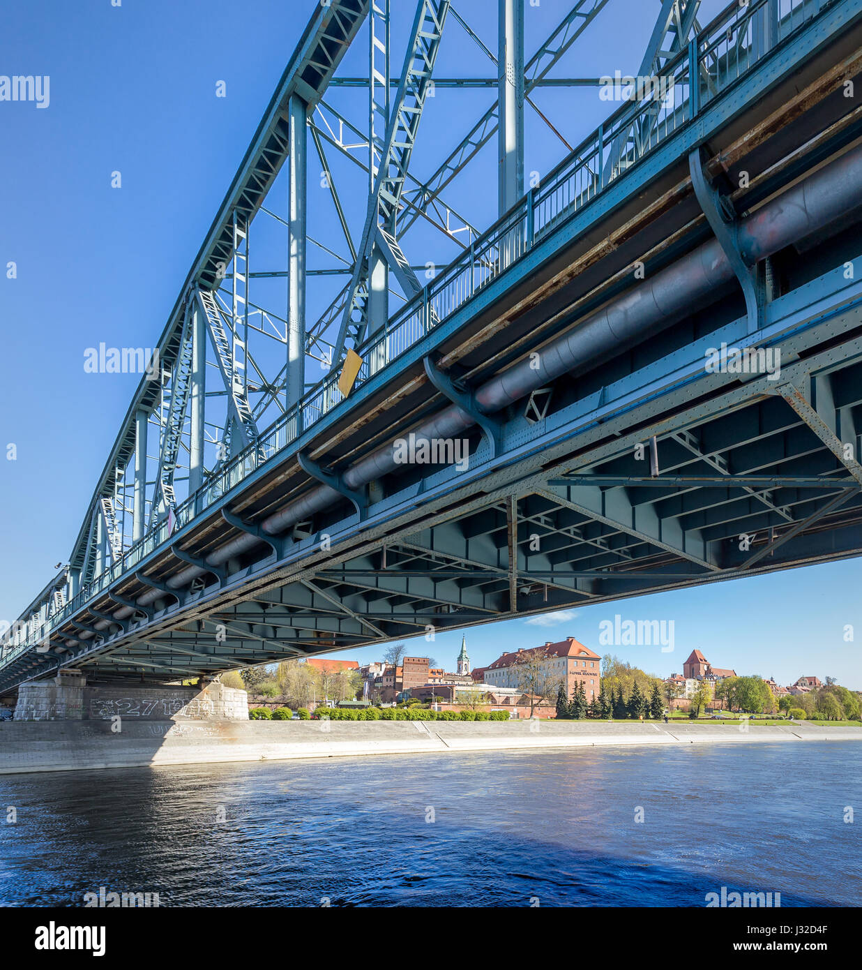 Arcged span bridge and view at Old City in Torun, Poland. - Stock Image