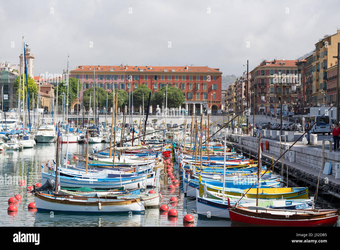 France, Nice, colourful old wooden fishing boats in the harbour. Stock Photo