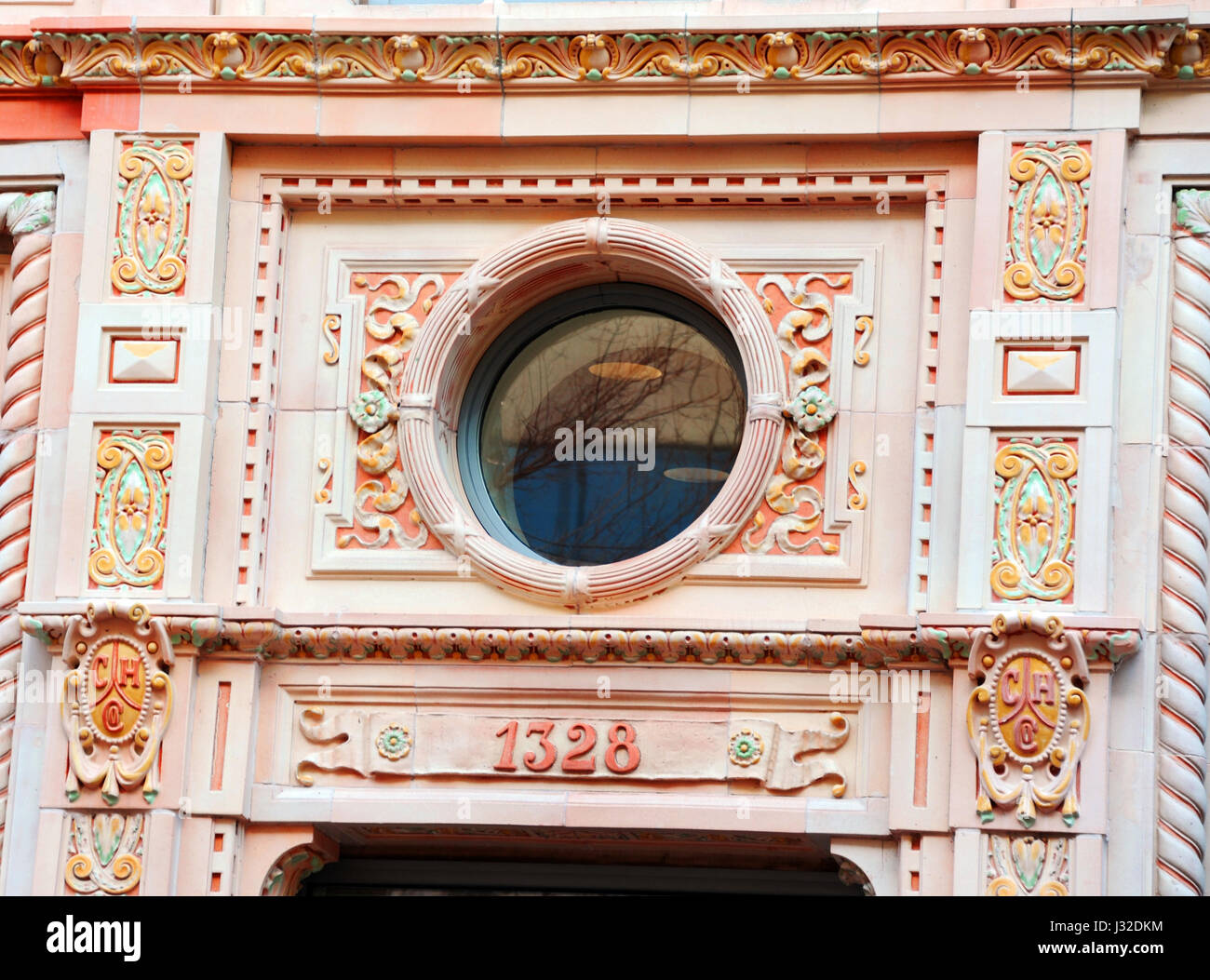 Beautiful terra cotta facade surrounds circular window on the Consolidated Building in downtown Columbia, South - Stock Image