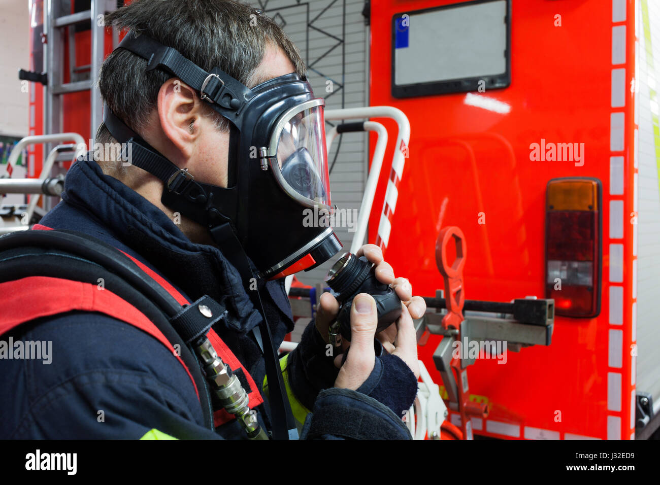 German firefighter with mask in action - Stock Image