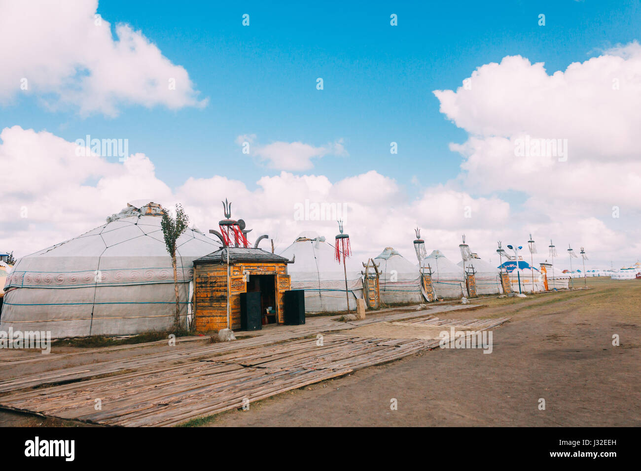 Landscapes of Mongolia, yurts against the backdrop of blue sky - Stock Image