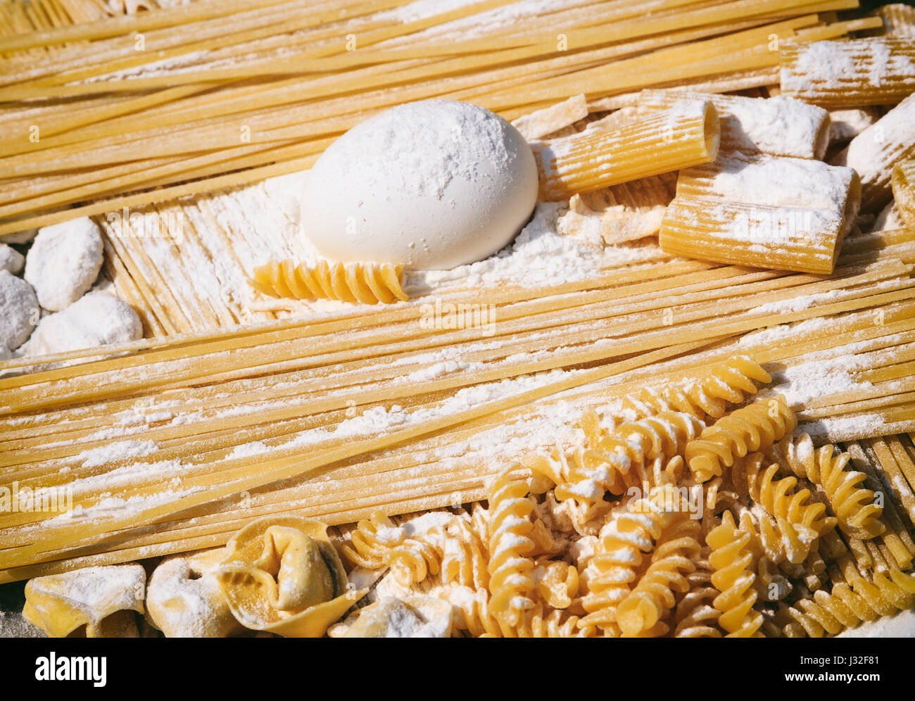 Raw Italian pasta and ingredients - pasta preparation - Stock Image