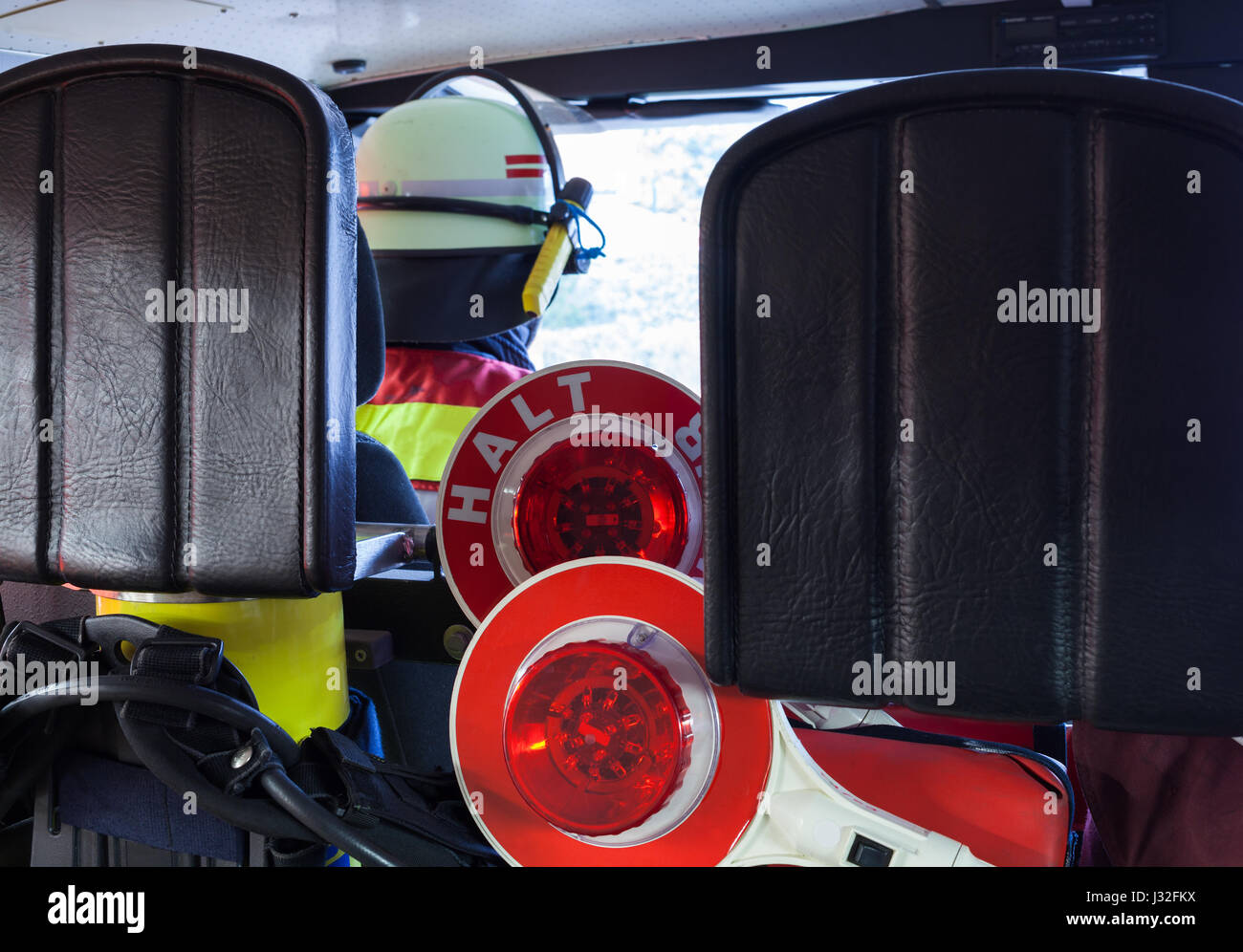 German firefighter in a emergency vehicle with halt-stop trowels - Stock Image