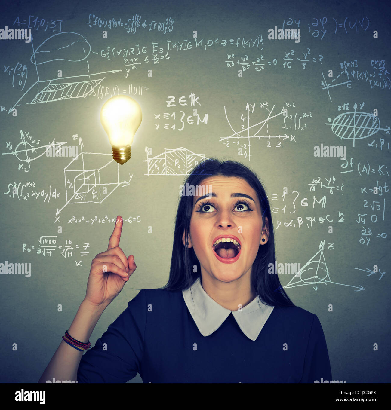 smart student with idea light bulb and various high school maths and science formulas on background - Stock Image