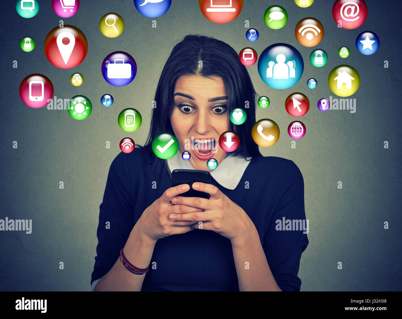 communication technology mobile high tech concept. Closeup surprised young woman using texting on smartphone with - Stock Image