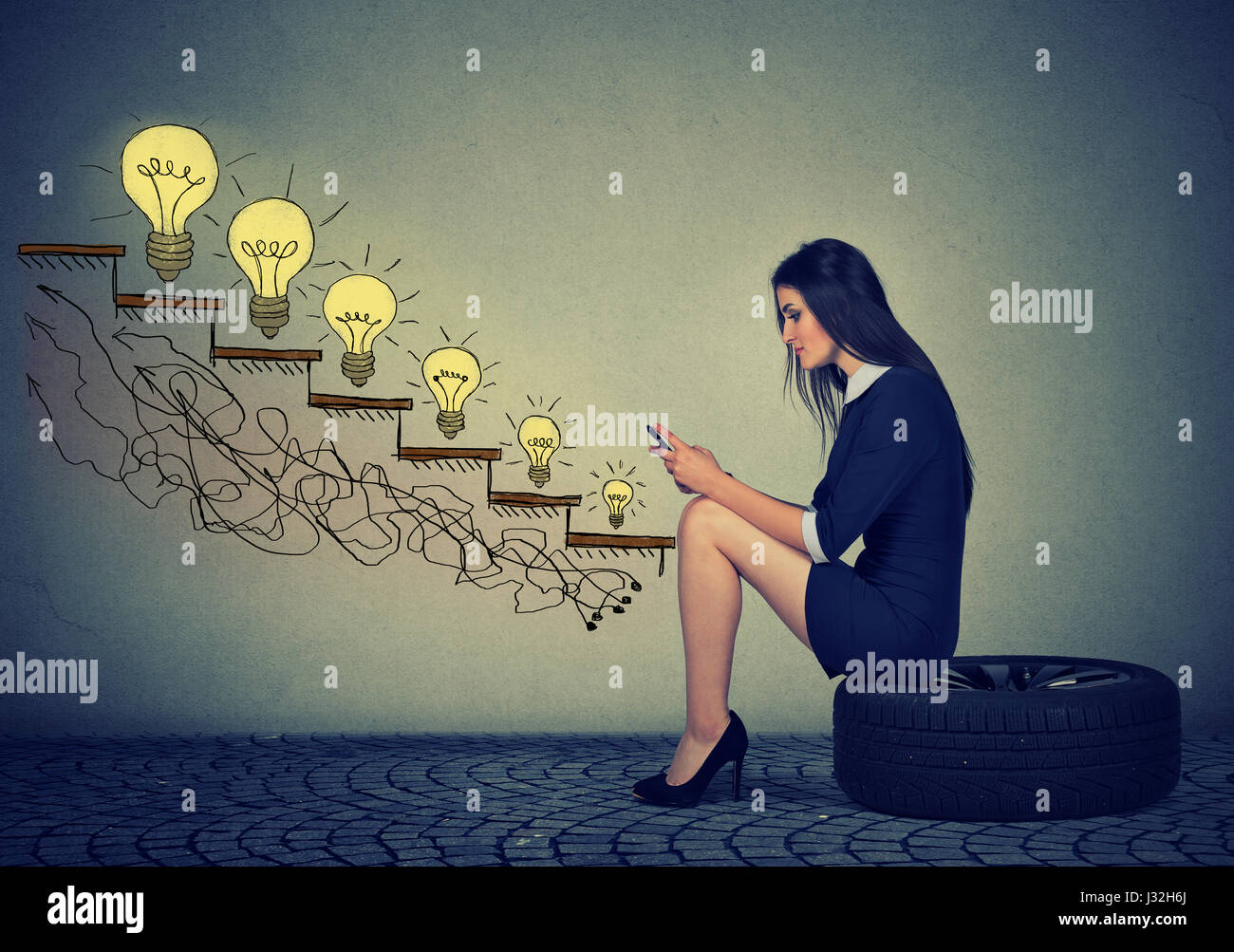 Happy young woman sitting on a wheel in front of growing up light bulbs. Business education success, promotion, - Stock Image